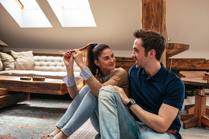 Cropped shot of an attractive young couple talking in the living room