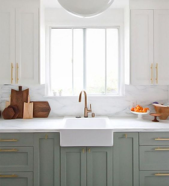 The renovated kitchen of designer,  Sarah Sherman Samuel . Love the color palette here with that fresh, clean look and pops of modern accents.