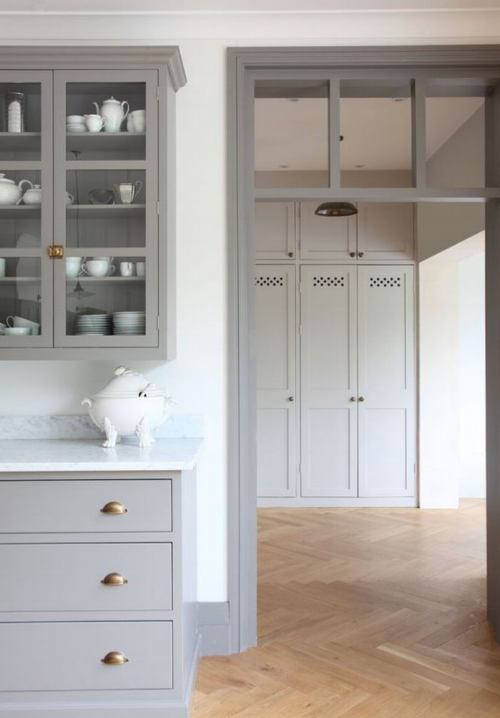 I was drawn to this space because of the cabinet and trim color that carries throughout and the wood floor tone is similar to what we have in our home. This space feels clean and fresh, but totally pulls that classic, old home vibe. Also note the brass hardware and simple lighting.  (*source via Pinterest....could not find the designer!)