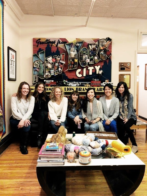The lovely lady Lion Brand Bloggers (Tamara of  Moogly Blog , me, Jess from  Make and Do Crew , Ashleigh from  Sewrella , Stephanie from  All About Ami , ChiWei from  One Dog Woof , and Jessica from  Mama in a Stitch )casually hanging out in LB CEO and President David Blumenthal's office.
