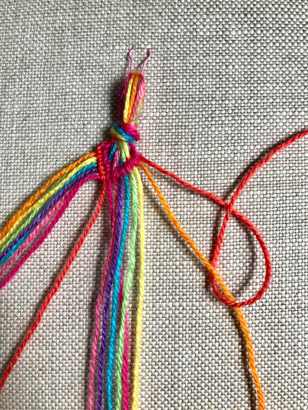 17. Now begin the right half of the second row, working a  backward knot  with the right most thread as the working thread.