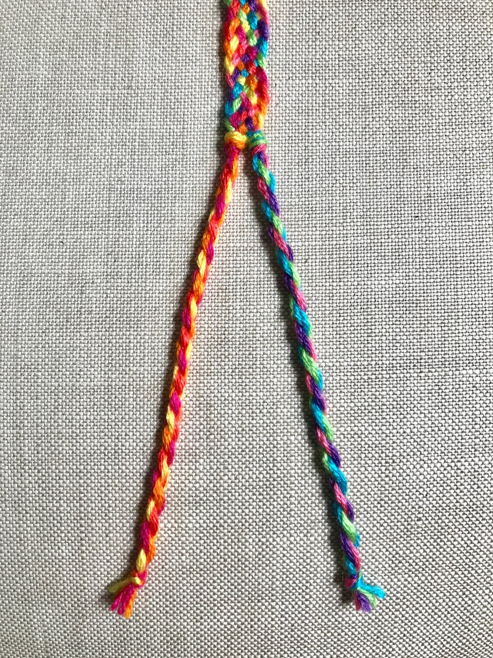 12. Repeat steps 19-24 from the Rainbow Chevron Bracelet to create the two rope ties.