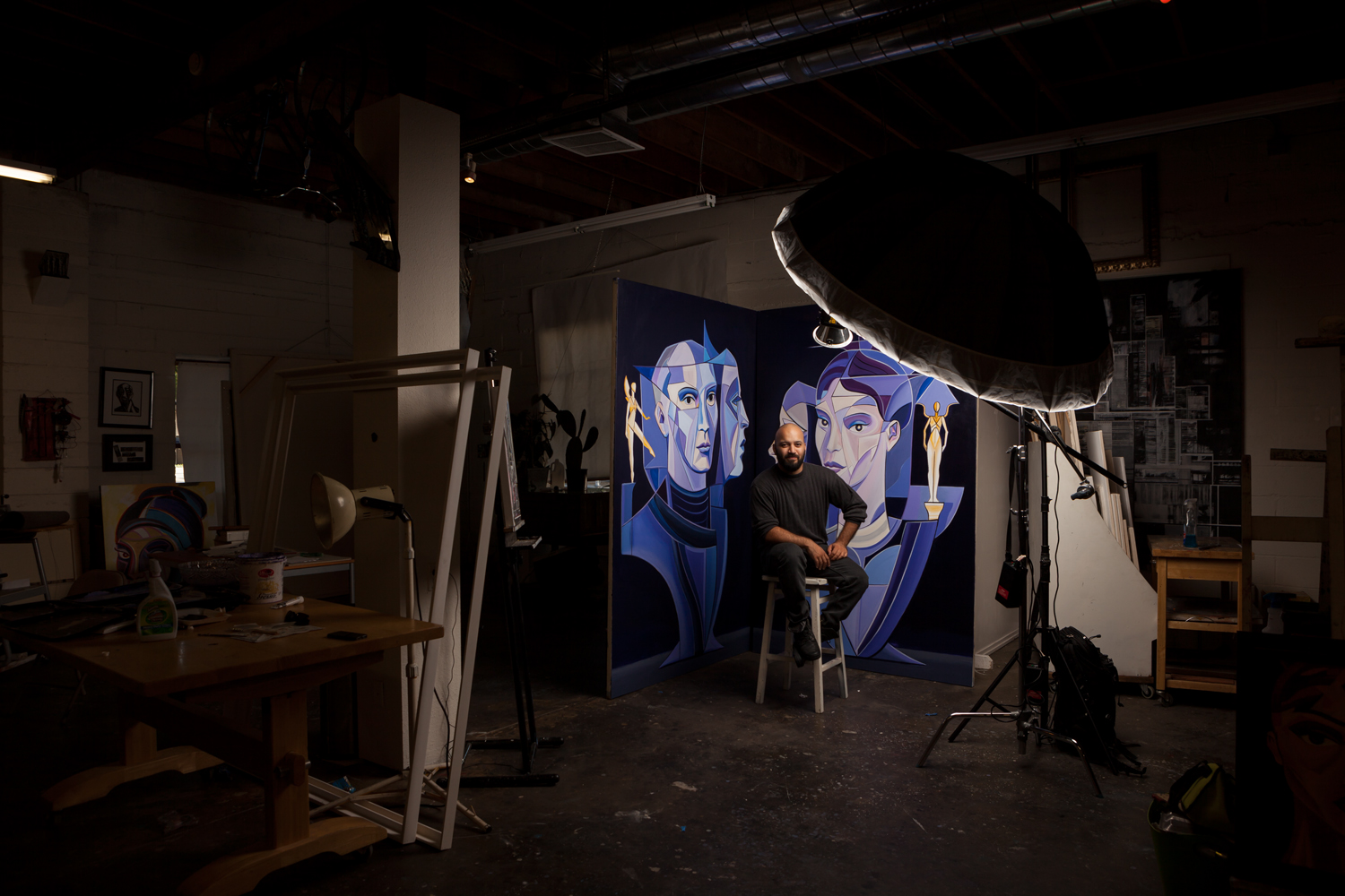 "Raphael Delgado in his Sacramento art studio, Sept. 2016. The paintings were done for a background to Capitol Dance Project's ballet performance of ""Portrait"" by Rex Wheeler."