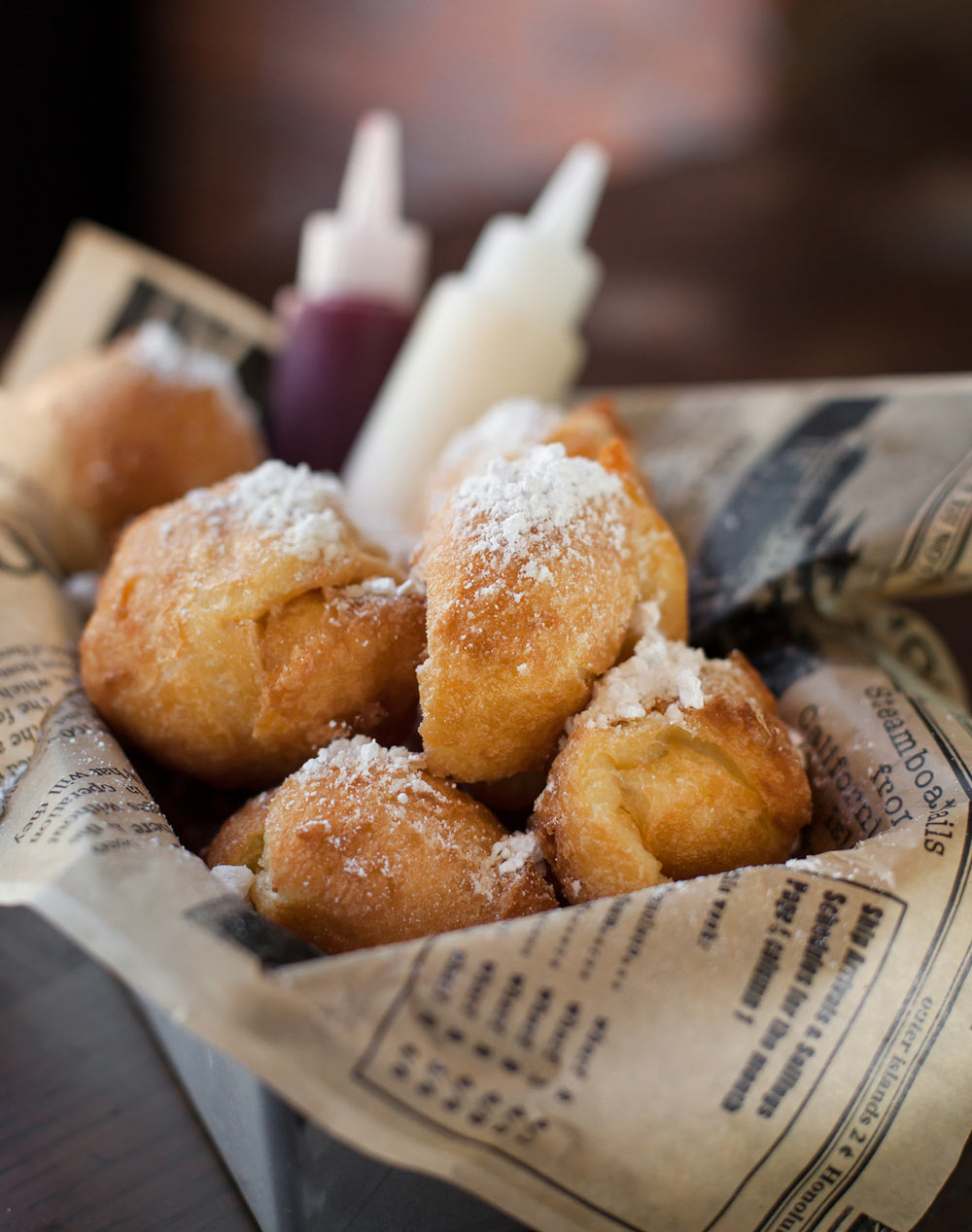 Food_photography_Beignet_Dipping_Sauce_Newspaper_Plating_French_Pastery_Powdered_Sugar.jpg