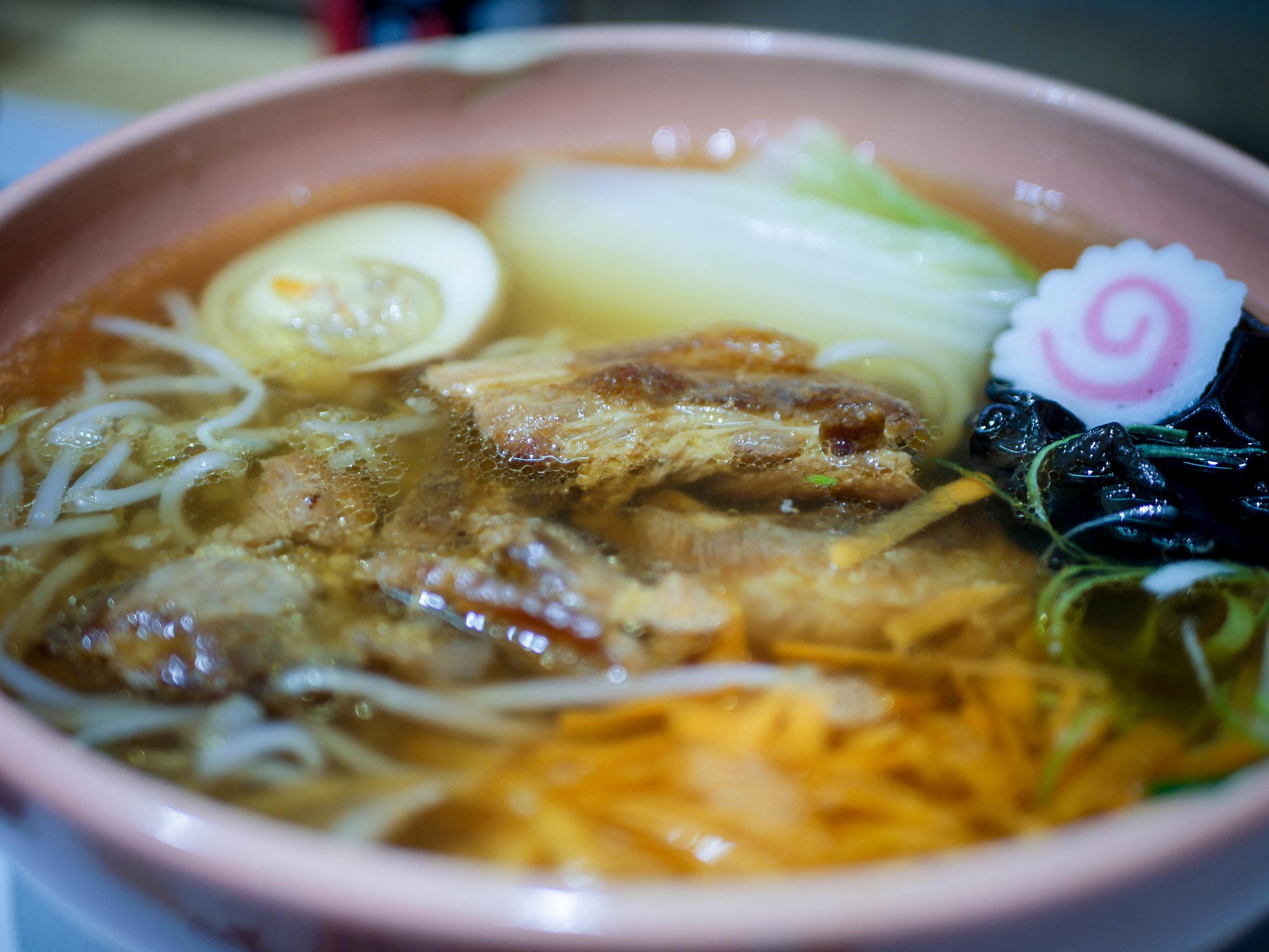 Pork based soup, noodle, chashu, egg, carrot, seasonal vegetables, naruto, shallot, wood ear mushroom, bean sprouts.