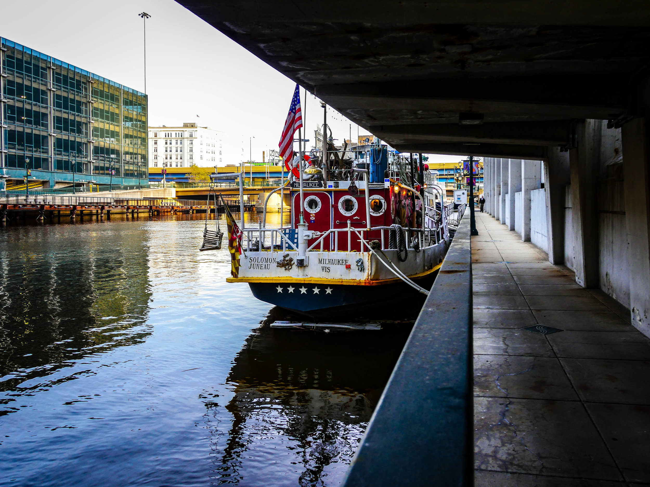 Boats hang out along the river walk on the Milwaukee River.