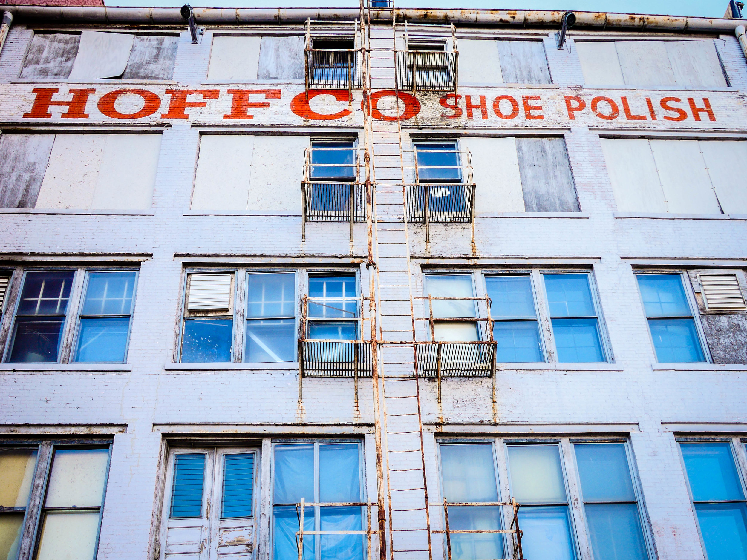 Industrial buildings of a bygone era line the river walk, though Hoffo Shoe Polish is still in operation.