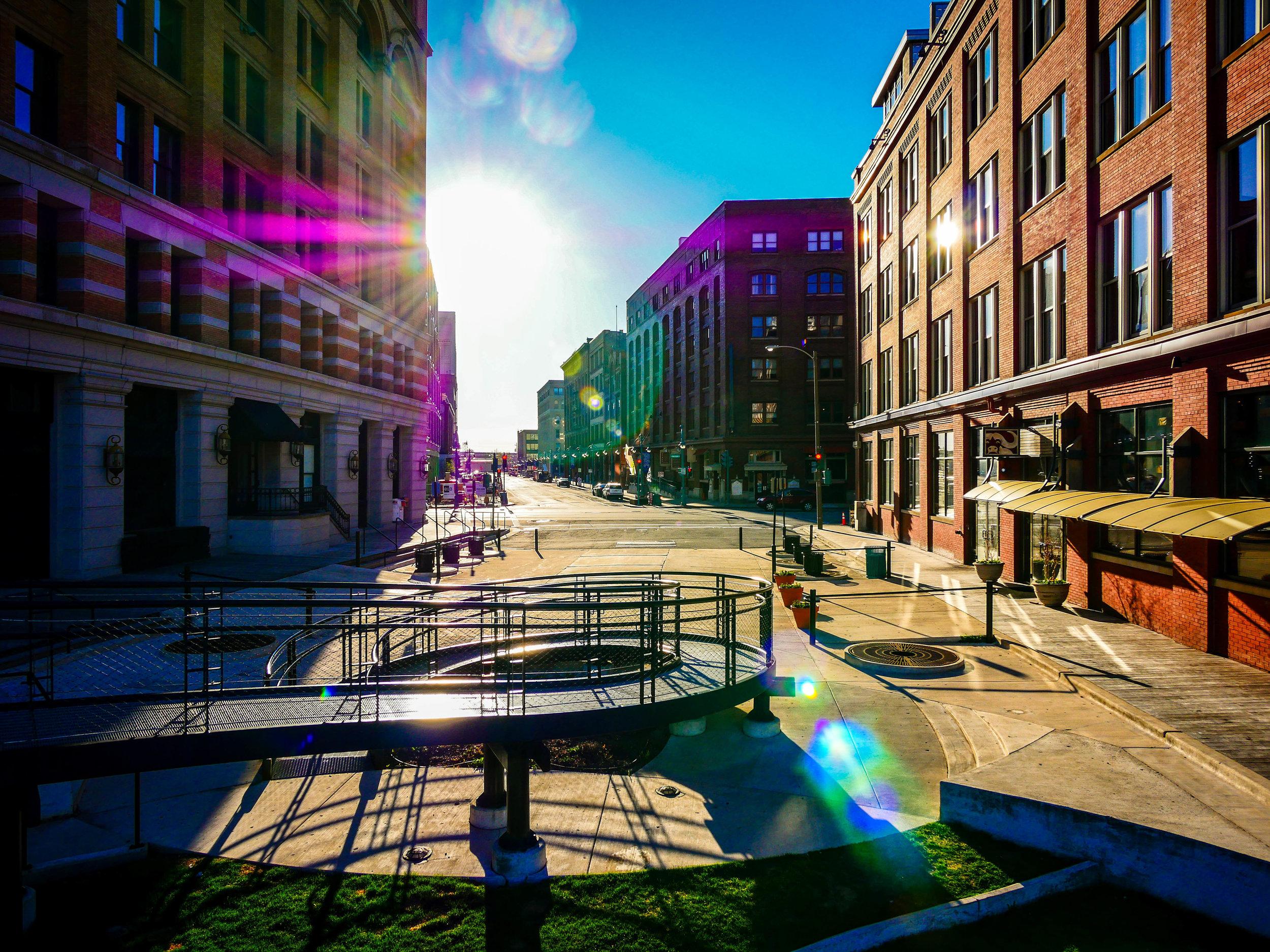 The sun rises over a downtown Milwaukee ramp.