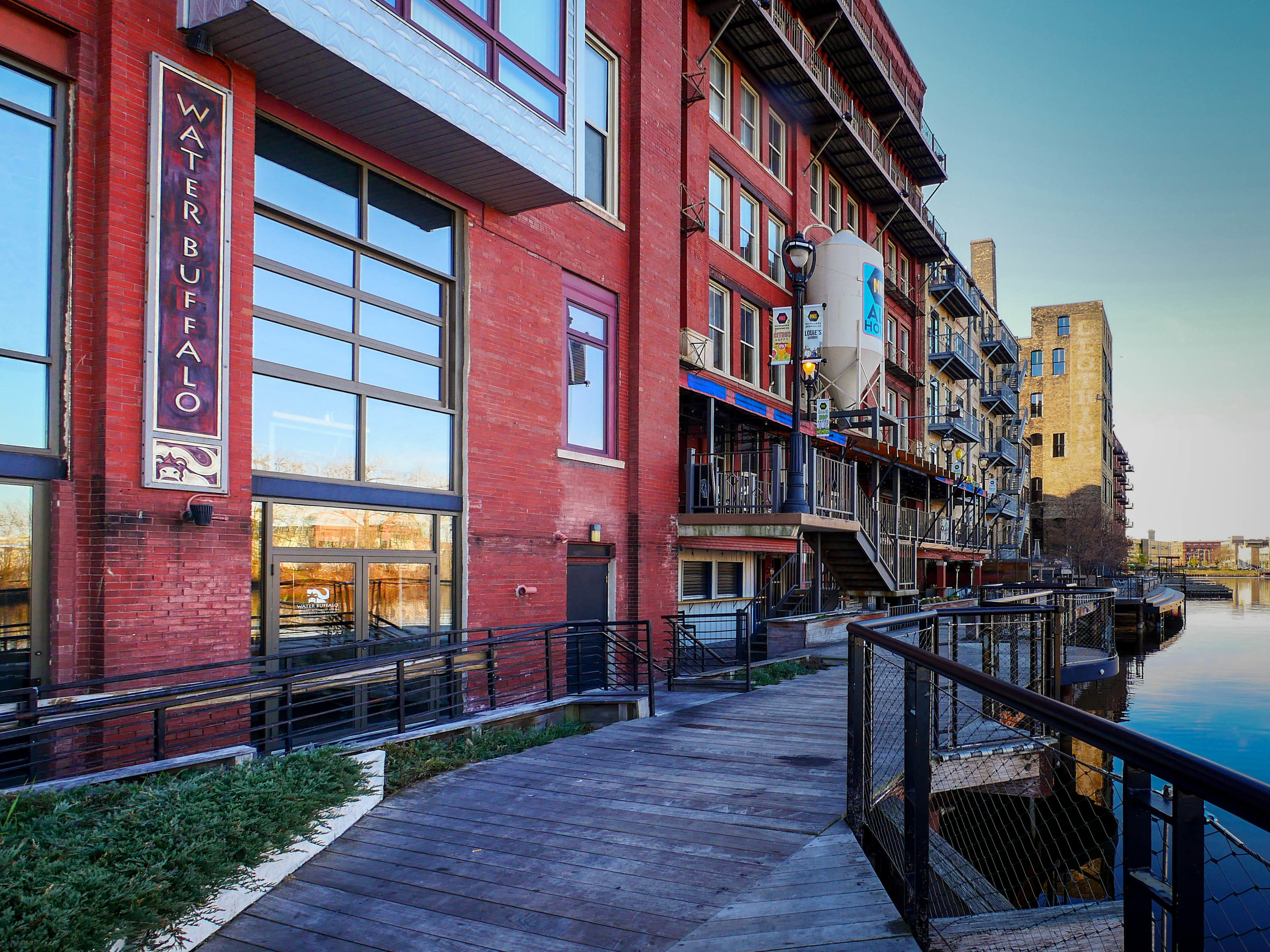 Eateries, cafes, and apartments look over the Milwaukee River.
