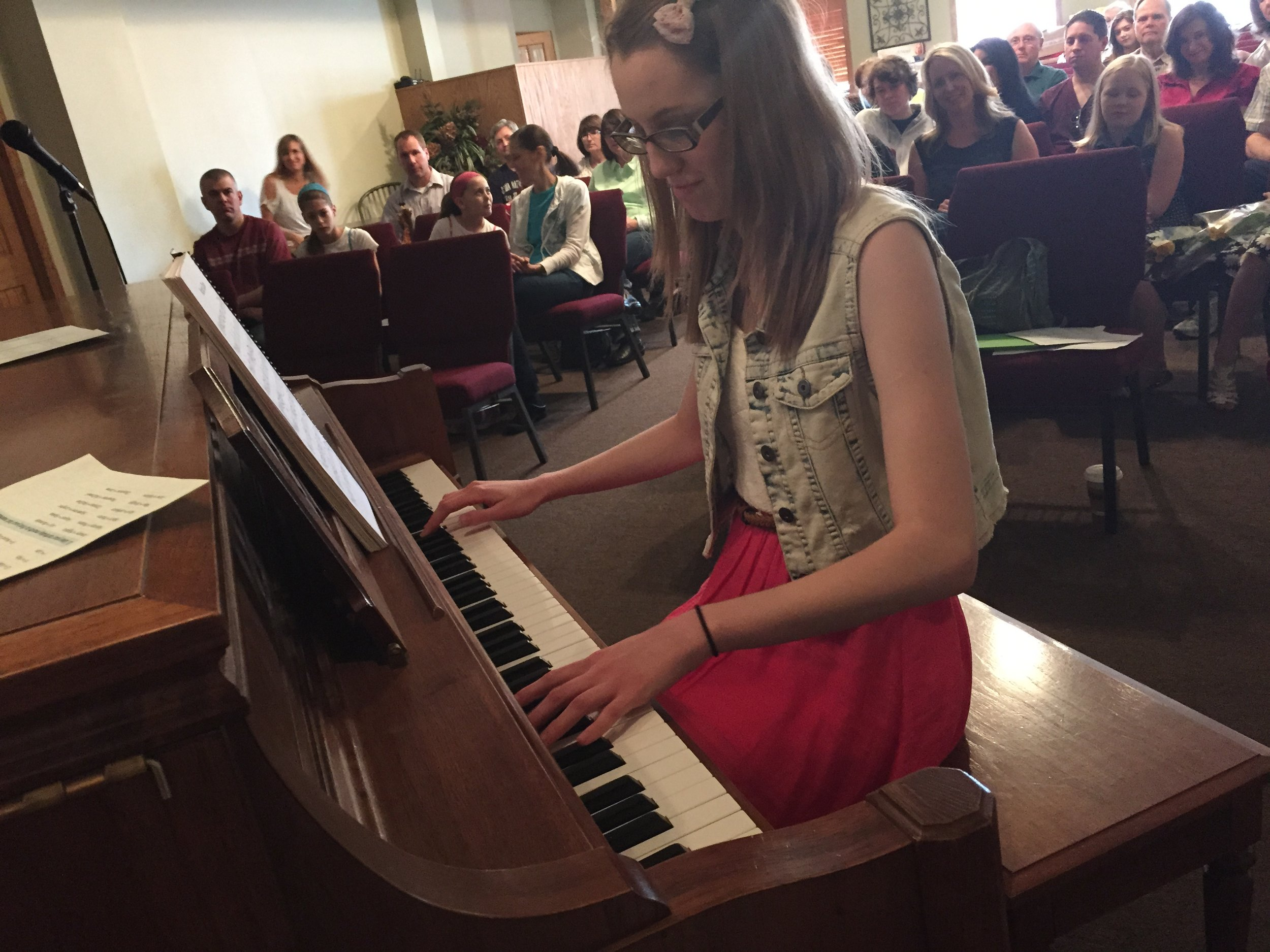Student (and my daughter) Leah playing at a Keys to Harmony event