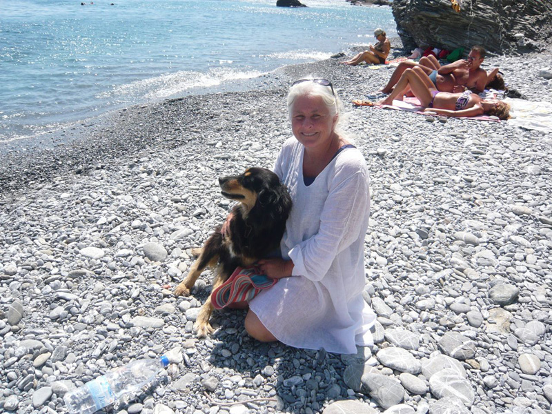 Rita, member of the Philozoike, with her rescued dog Cicla in Muros, Amorgos