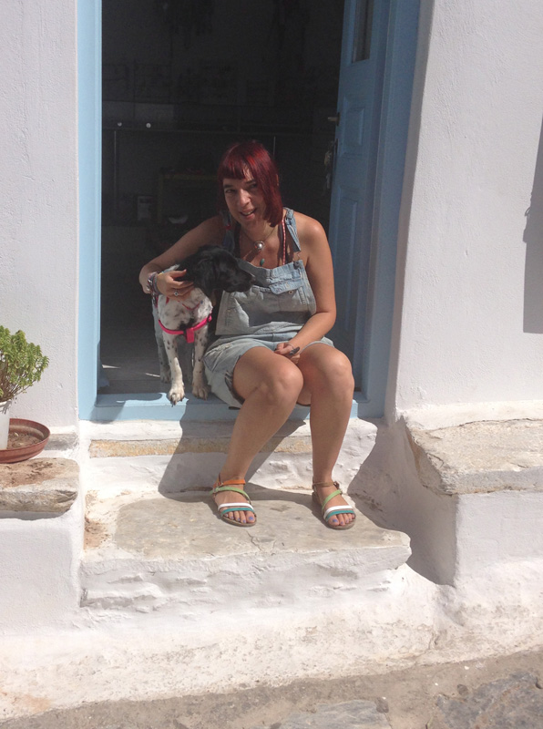 Our former rescue dog Sara with her new owner Angeliki Courti at her jewelry shop in Chora.