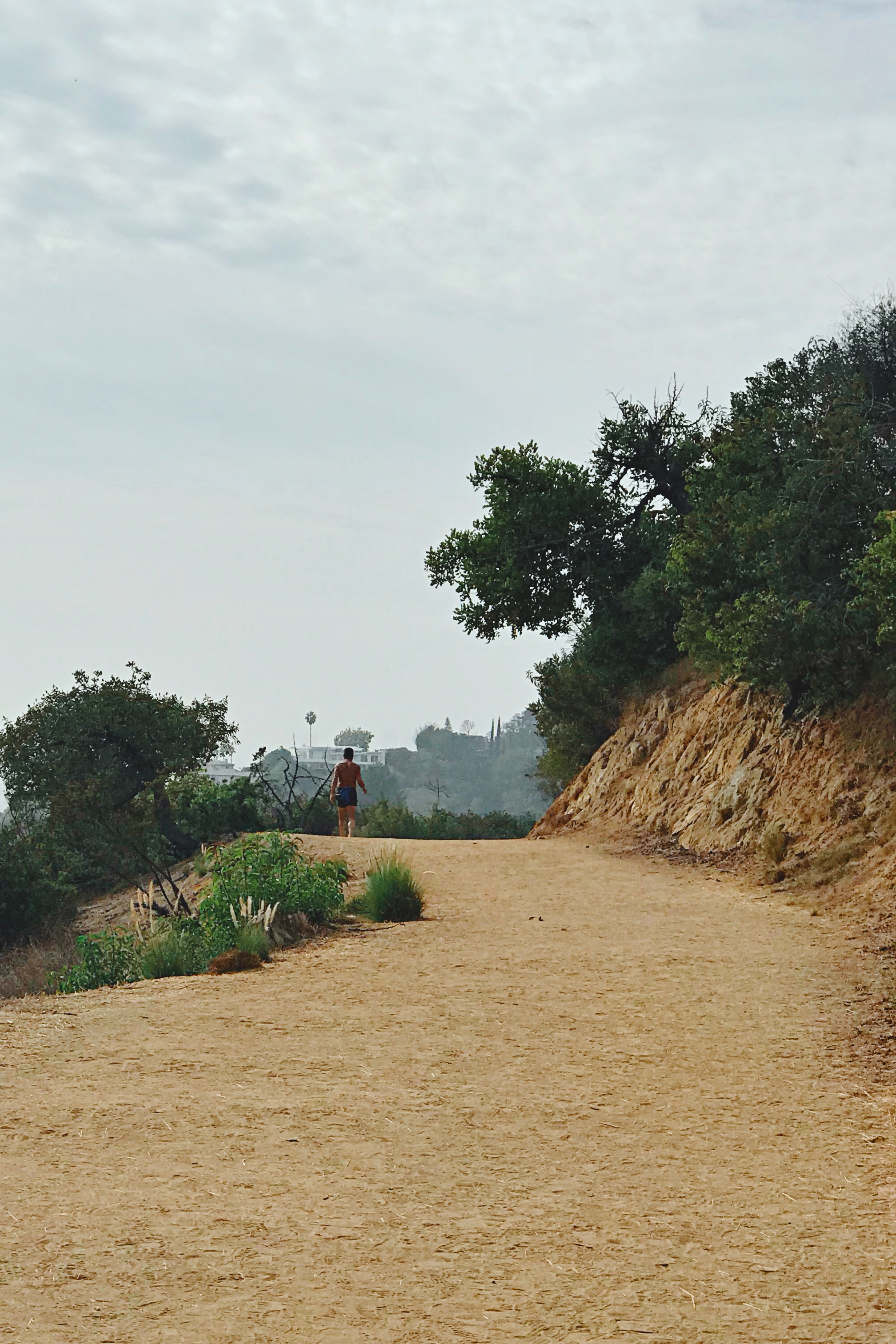 A barefoot jogger in Griffith Park