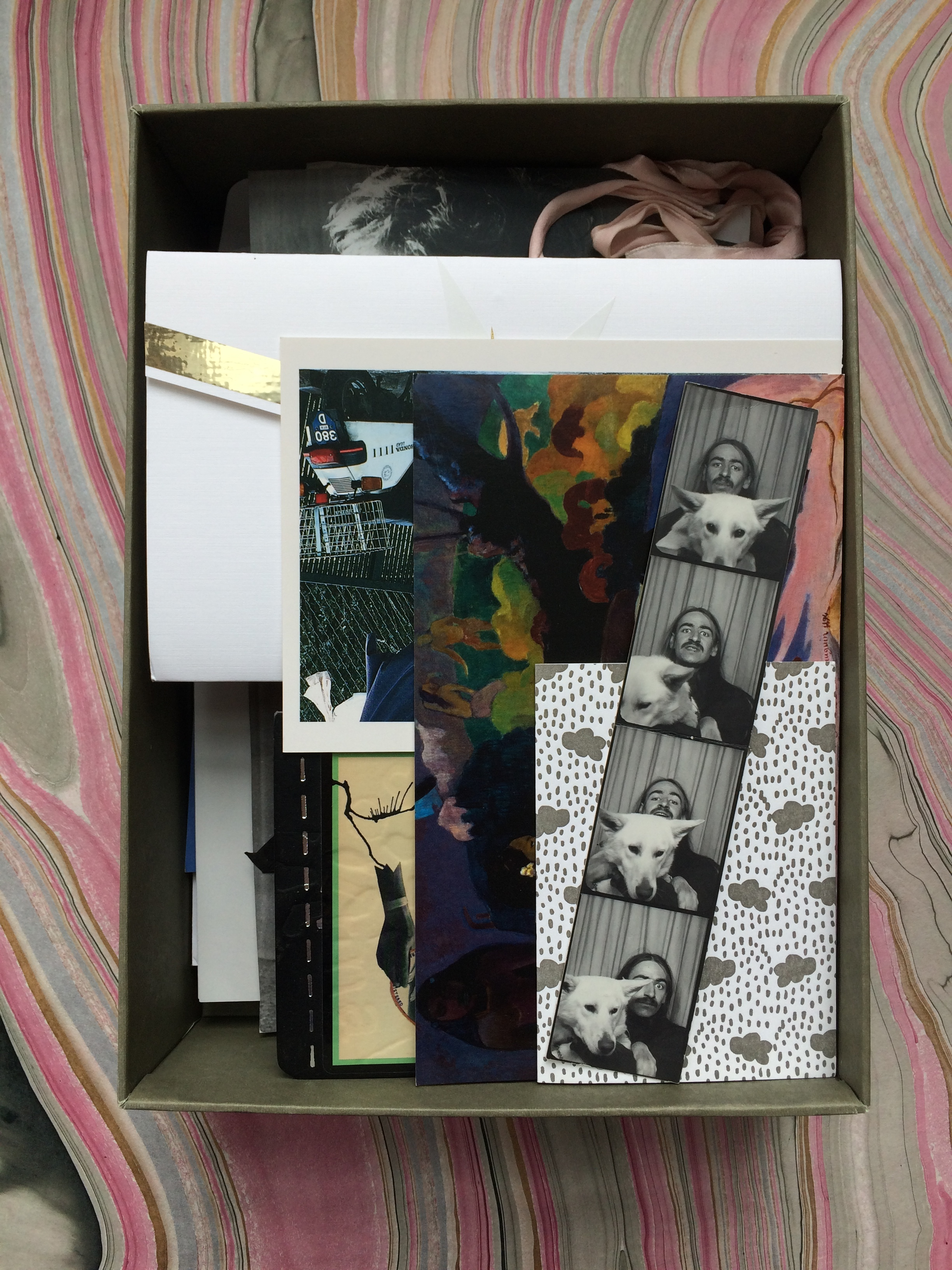 a box of stuff with a photobooth strip of dad