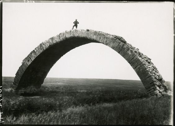An ancient Roman bridge spans the Wadi al Murr in Mosul, Iraq, 1920. Photograph via National Geographic