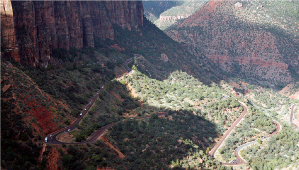 Zion Tunnel – The Zion Tunnel as seen from the Overlook. You can see the zigzag switchbacks in the road and where it enters the mountain at the base of the cliff on the left.