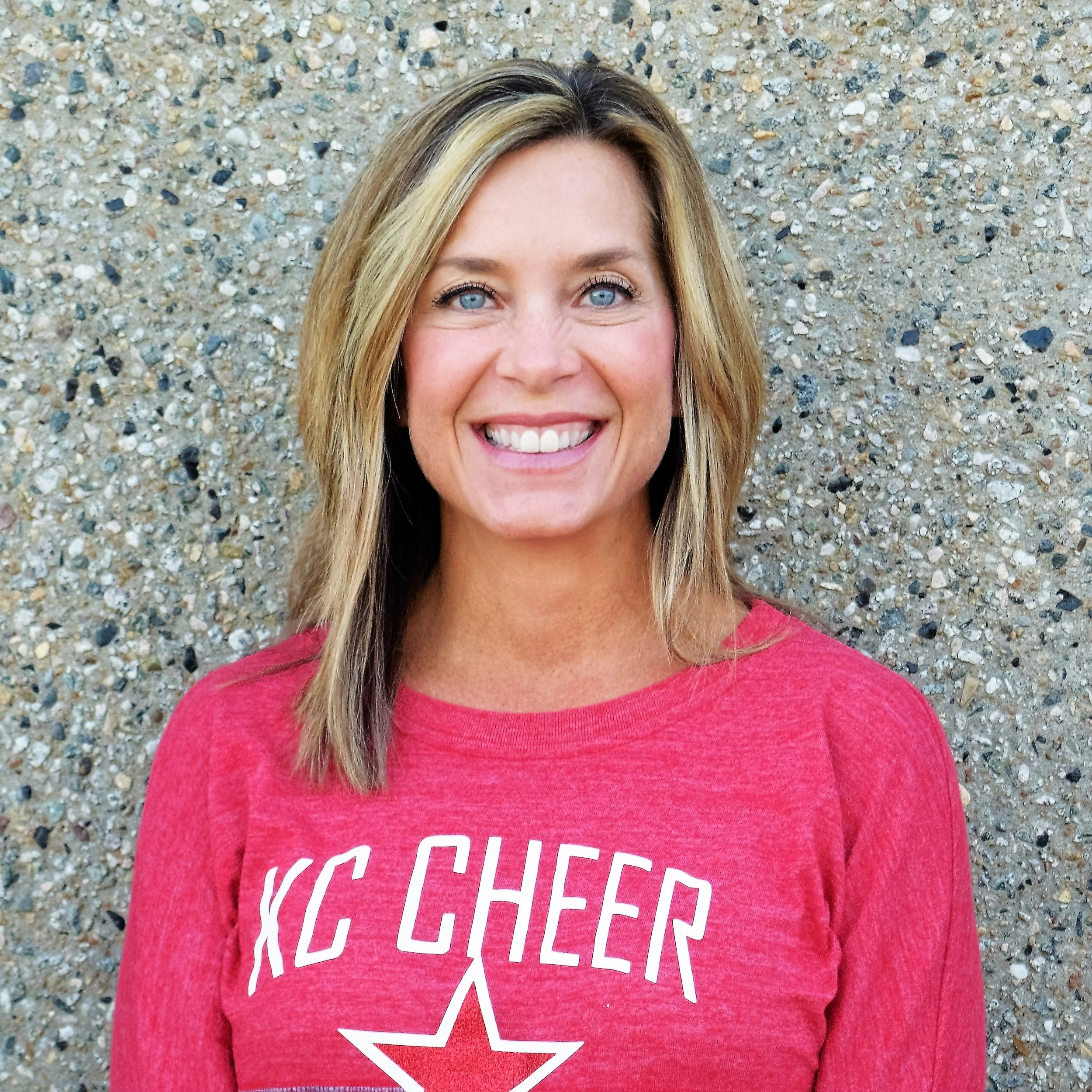 Kristi Whitney  Owner, Coach  Kristi is the co-owner of KC Cheer. She and her husband Michael graduated from Kansas State University. Kristi works with boys and girls of all ages in the gym, and is the primary contact for parent information and allstar program information. From the youth kids on Fual all the way to the level 5 teams, Kristi is there to teach them to have the confidence they need to perform to the best of their abilities. Kristi is a mom to Harrison, 23 and Ashleigh, 21.  Contact Kristi
