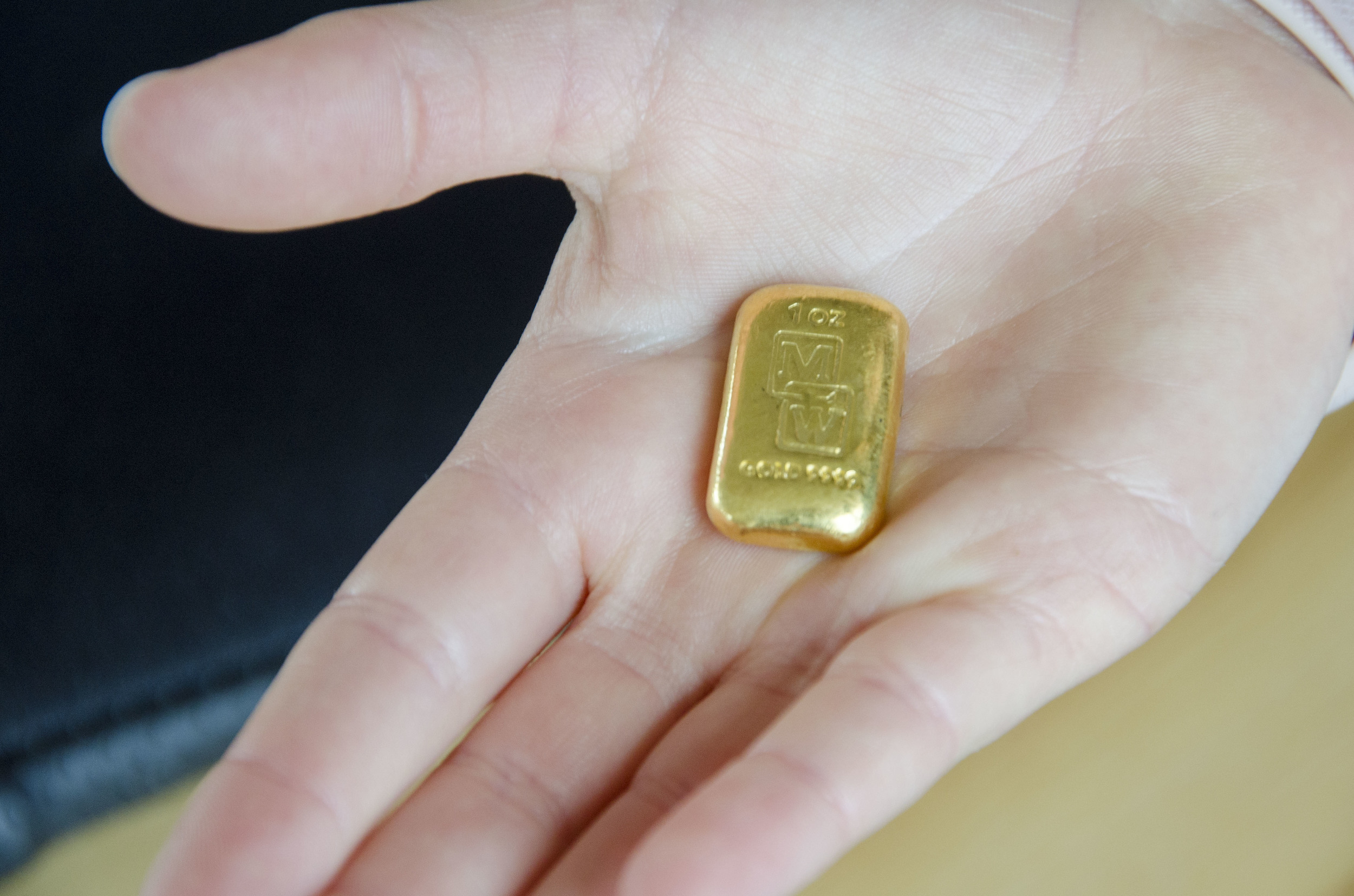 The gold ingot resting in my daughters 8 year old hand.Trying to make it look bigger!