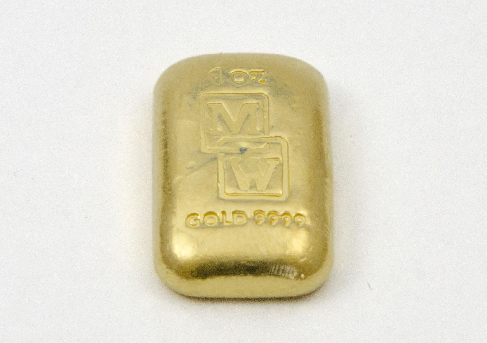 1oz Morris and Watson Cast  Fine Gold i ngot (31.10 grams).  Ingot dimensions (mm): 15(W) x 25(H) x 5(D)