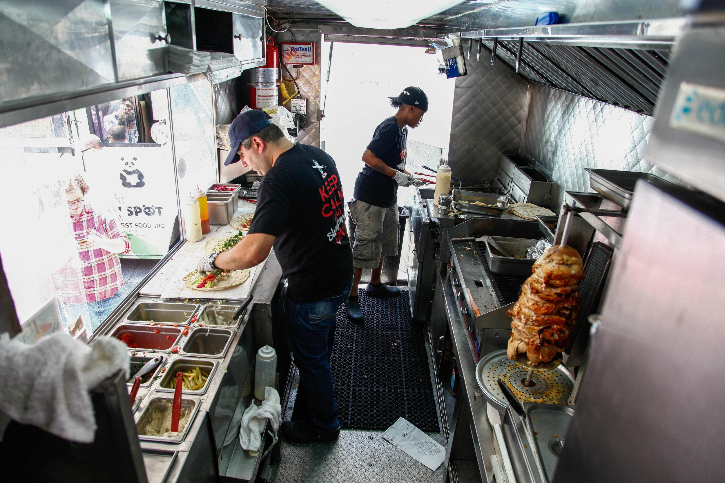 toum behind the food truck window.JPG