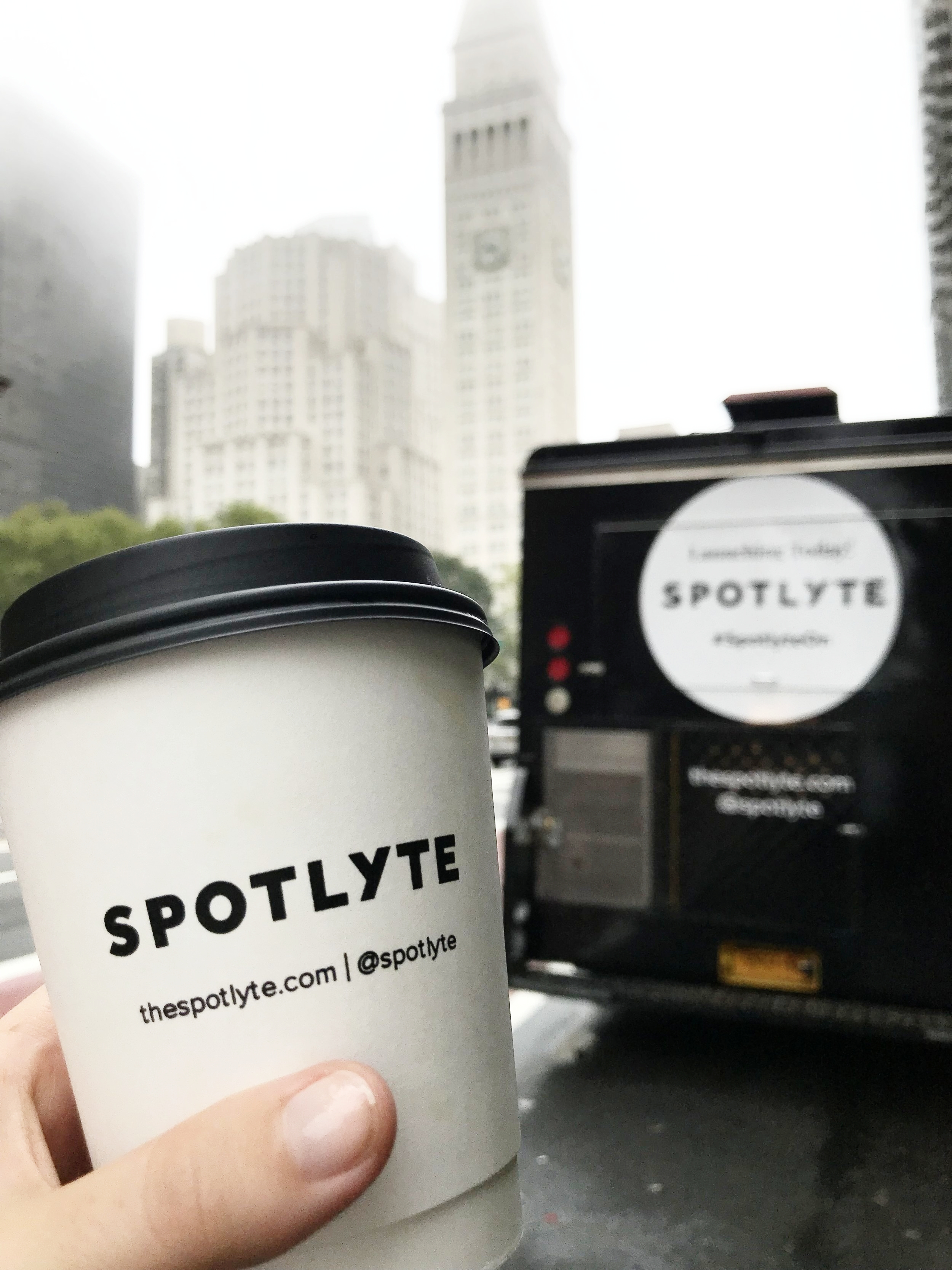 Spotlyte had custom paper coffee cups made to give out to commuters on their walk to work