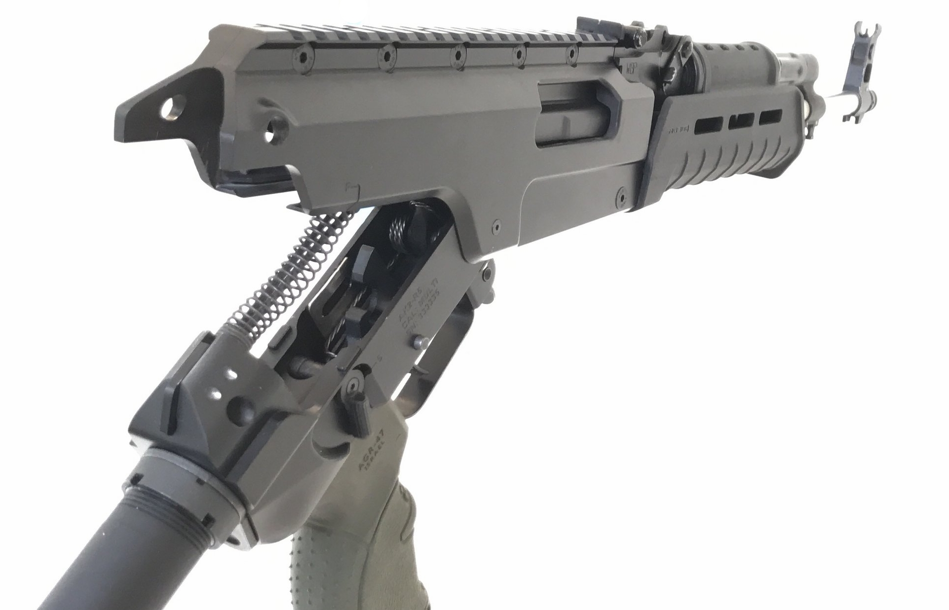 Upper and Lower Receiver  Disassembly is easily accomplished by removing the rear pin and pivoting the lower receiver down. The recoil spring and bolt carrier can be removed by sliding them out of the back of the rifle.