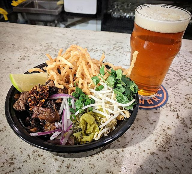 Over the next few weeks we will be featuring specials utilizing beef cuts from a cow that was raised entirely on the spent brewing grain of @stelmobrewing . Pictured here: St. Elmo Angus Khao Soi with beef shoulder smoked by our friends @leroyandlewis . Soursop's smoky take on the Northern Thai Classic:  curry noodle soup with fresh and crispy egg noodles, pickled mustard greens, bean sprouts, fresh herbs, and chili crisp. Smoked beef fat was also used to make the curry broth.  Recommended pairing Slater IPA 🍻 #whilesupplieslast