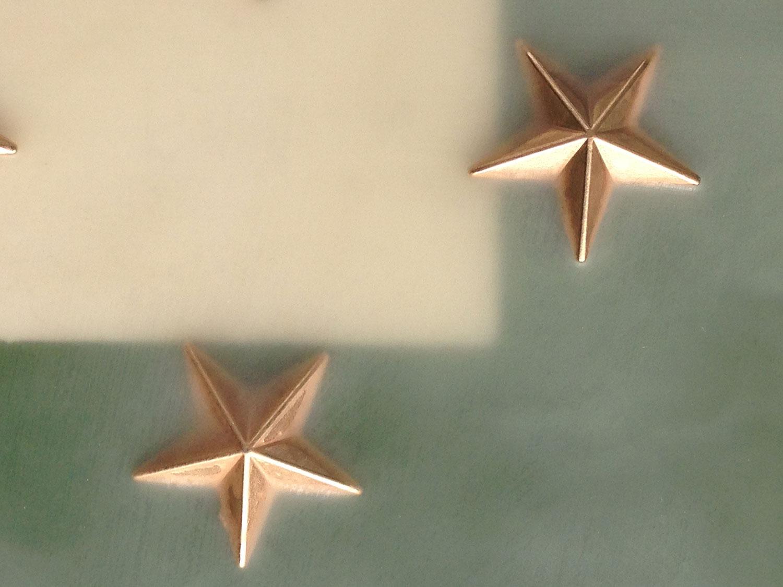 Medical marijuana cross in star-field hosting 50 gold 5-point stars.