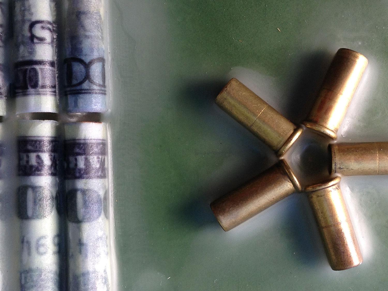 Brass spent bullet shells replace 5-point stars.