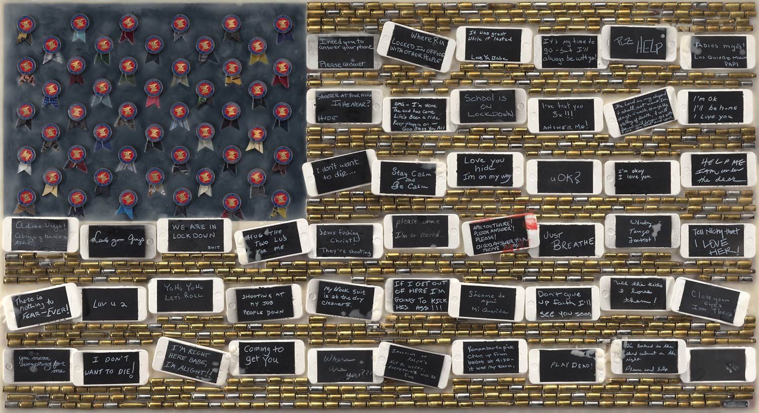 """Last Text, 2016, 26X48"""",Plaster cell phones, spent gun shells, NRA badges, and encaustic on board."""