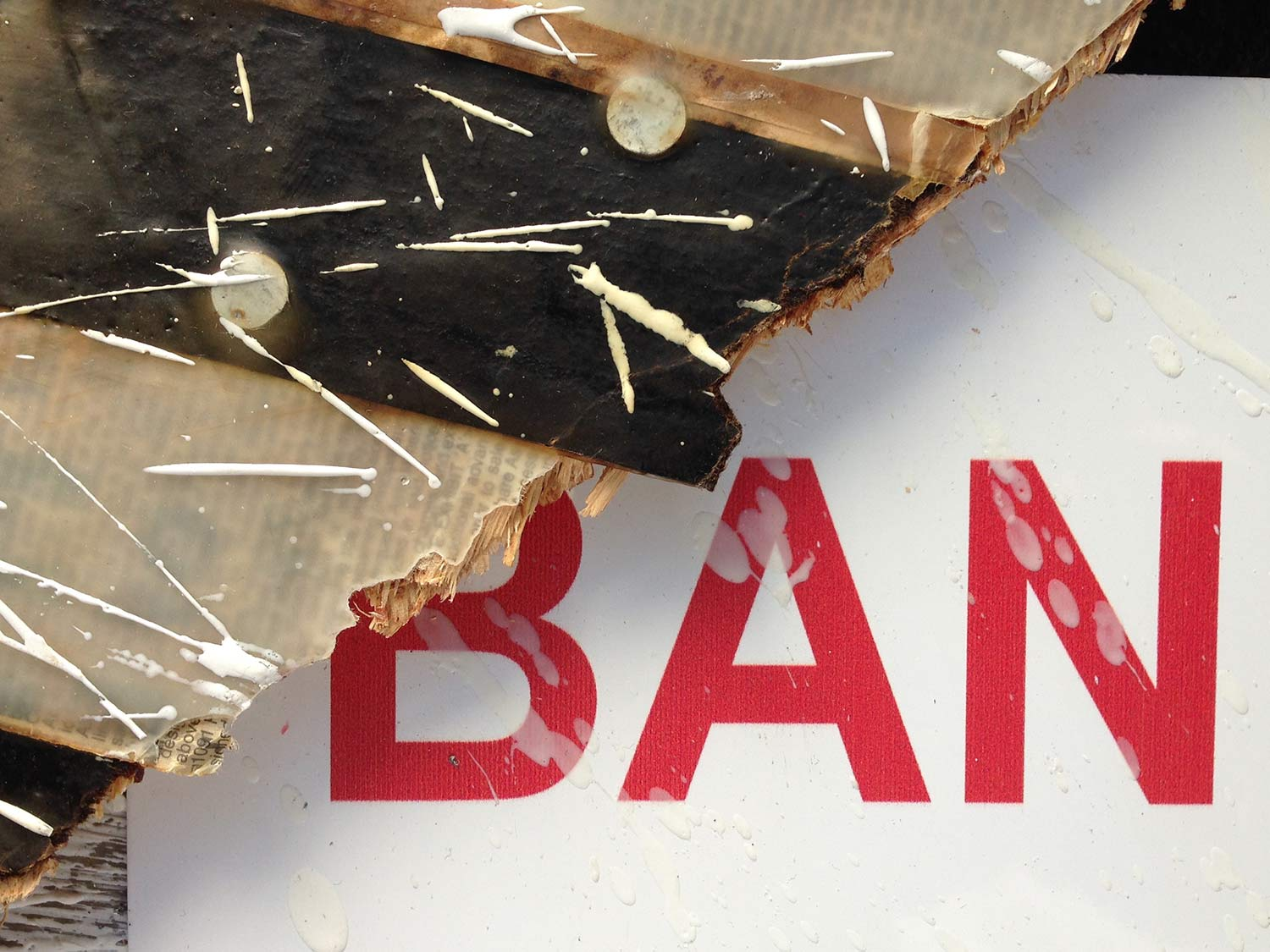 "Bank Owned, 2012, Detail 26x48"" Engineered plywood, roofing felt, roofing nails, repossessed home owners keys, foreclosure sign and encaustic on board."
