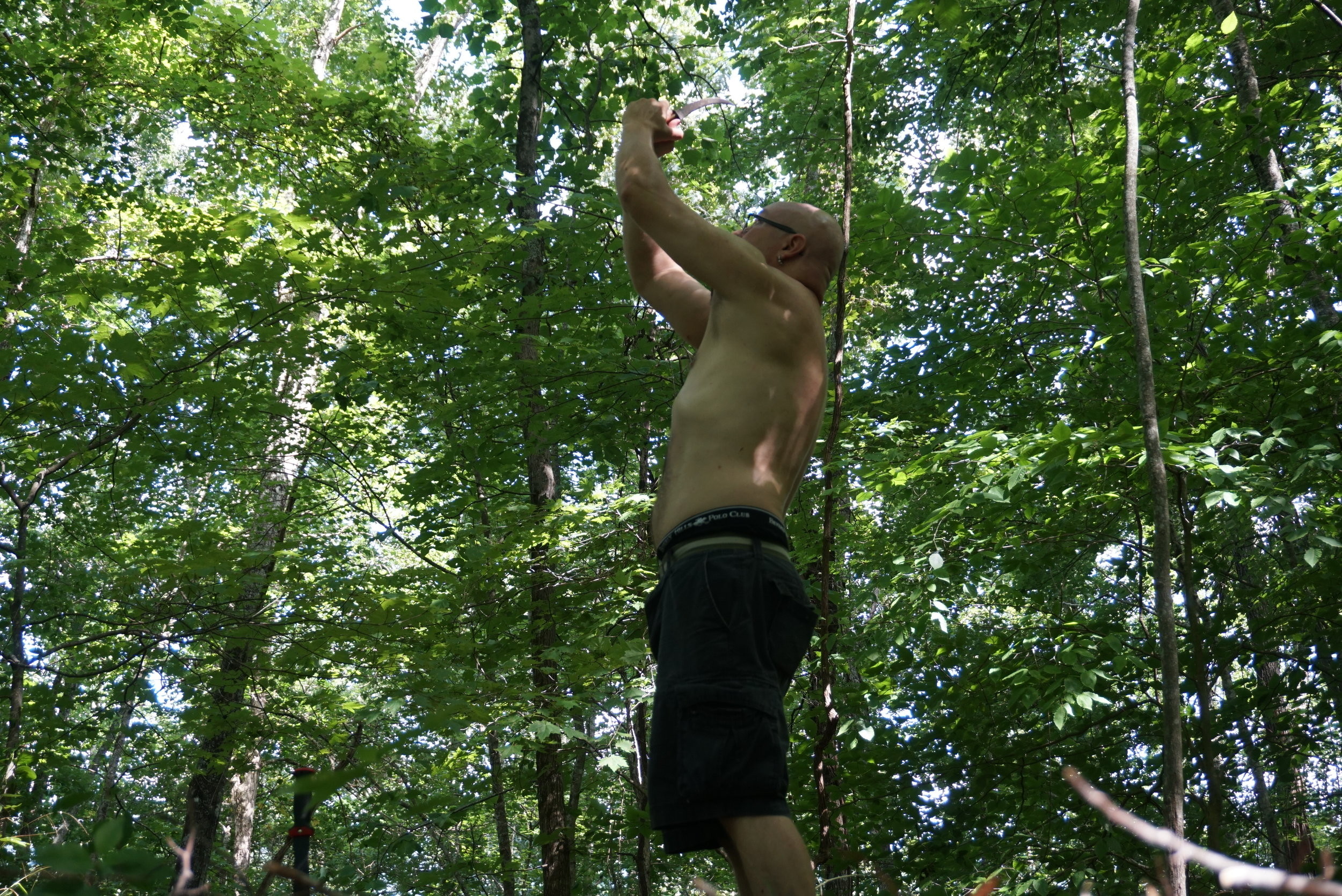 Me atop a mountain out from our back yard doing ritual with the koummya dagger.