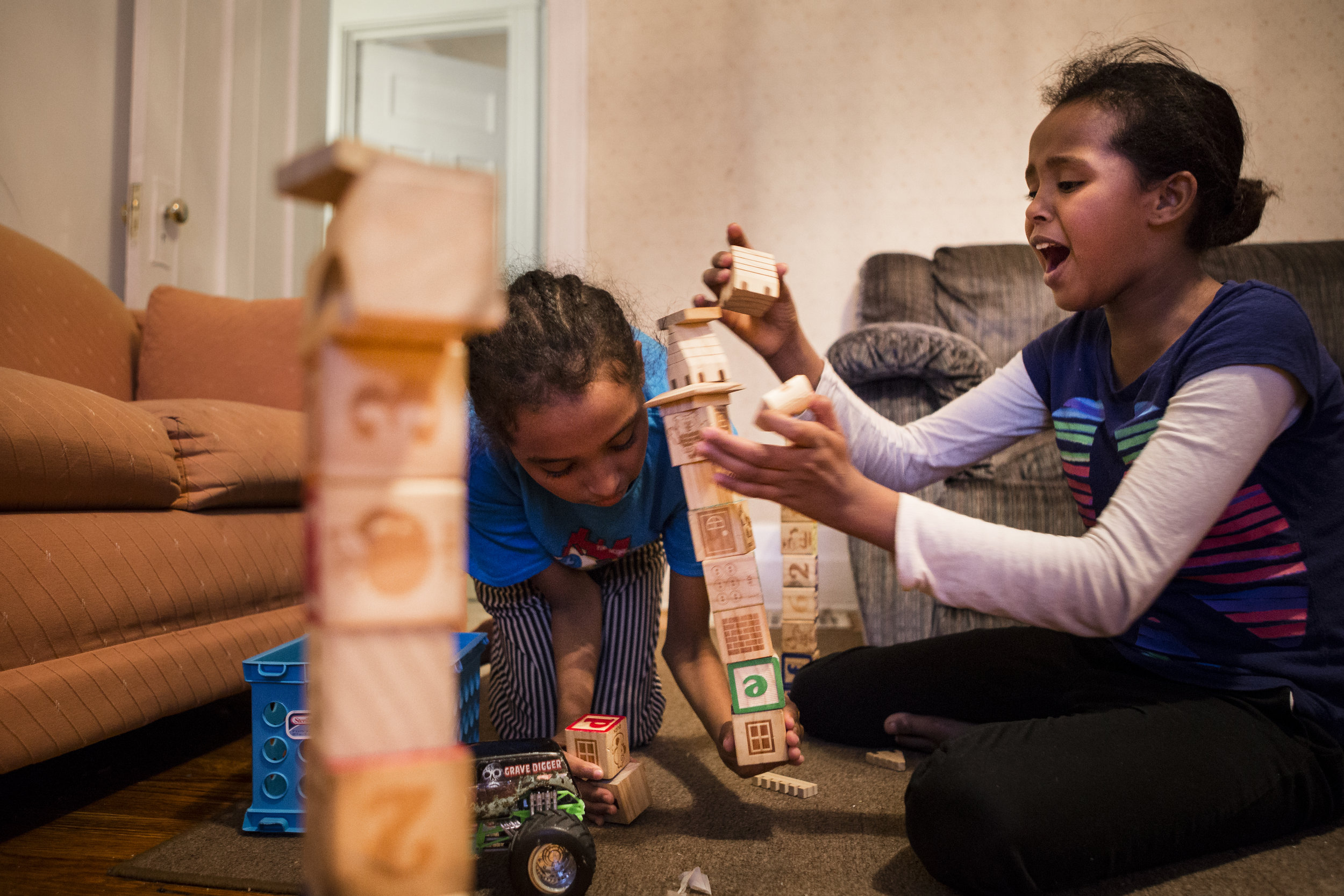 Twins Najma (right) and Nadira play with blocks on a Thursday evening. Dec 1, 2016