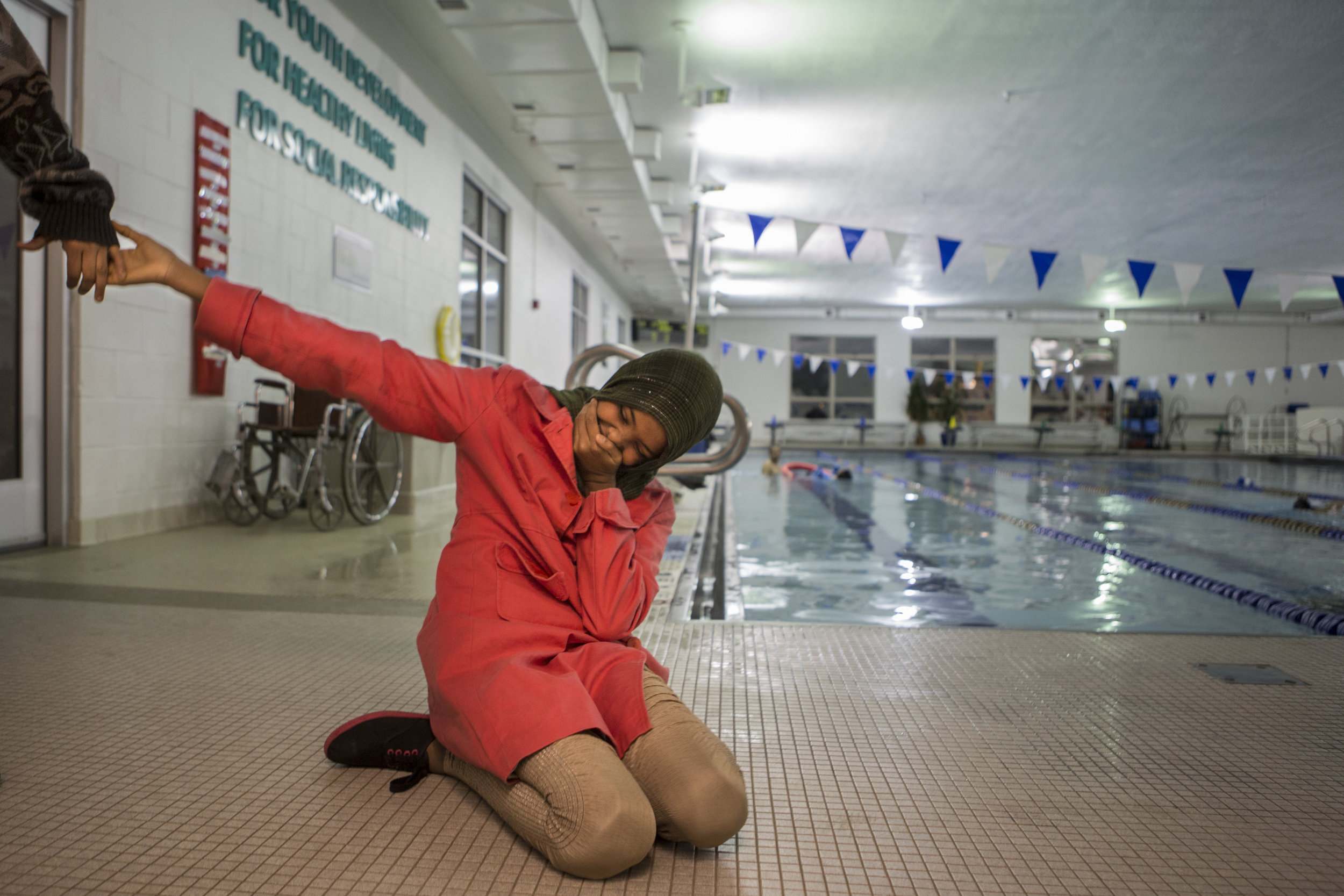 Adna reacts to seeing the community pool at the local YMCA. Apart from drawing, Adna loves swimming and being in the water. After visiting the library, the children visited the YMCA to tour the facilities. Dec 2, 2016.