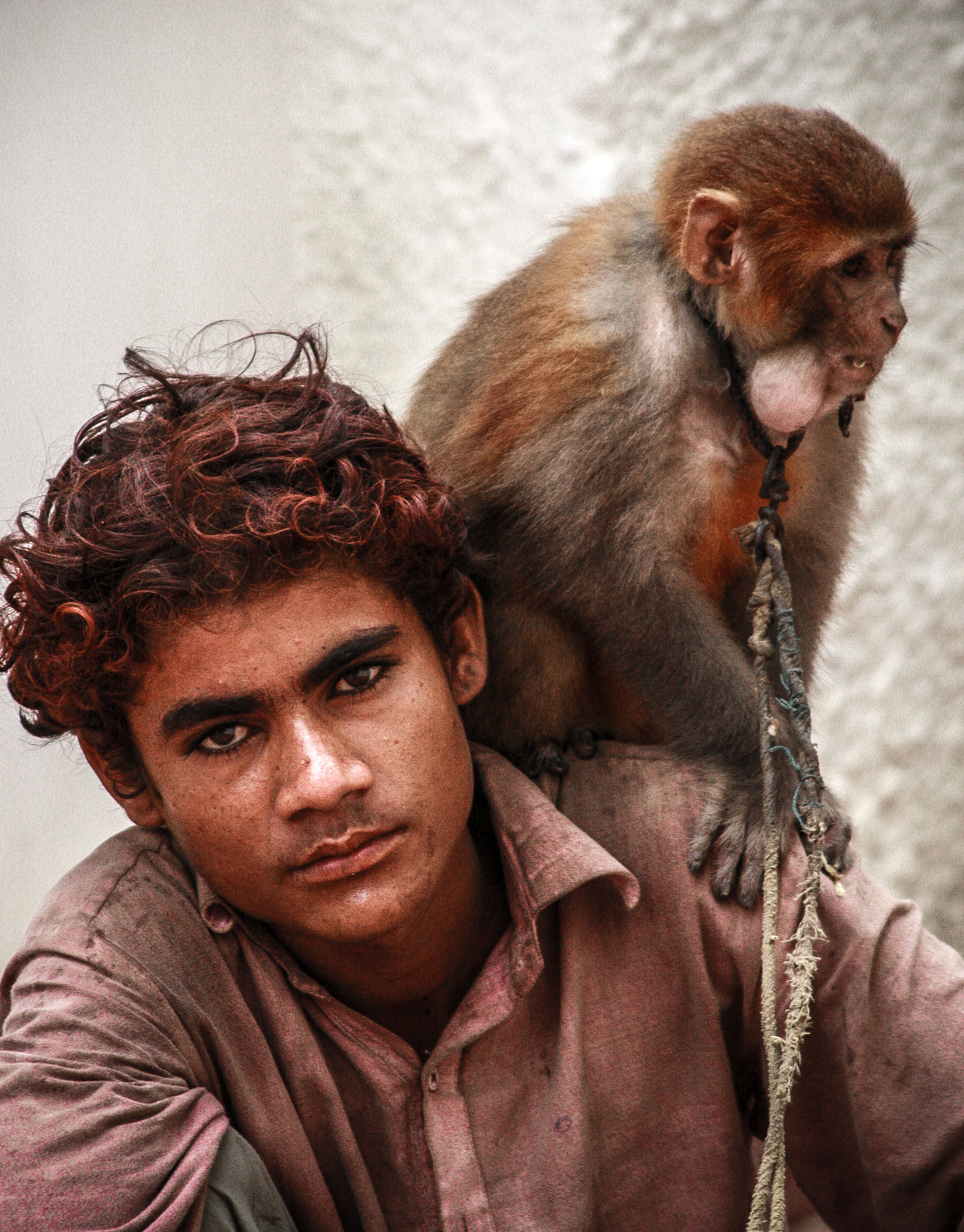 Street-performer and his monkey. Karachi, Pakistan 2008