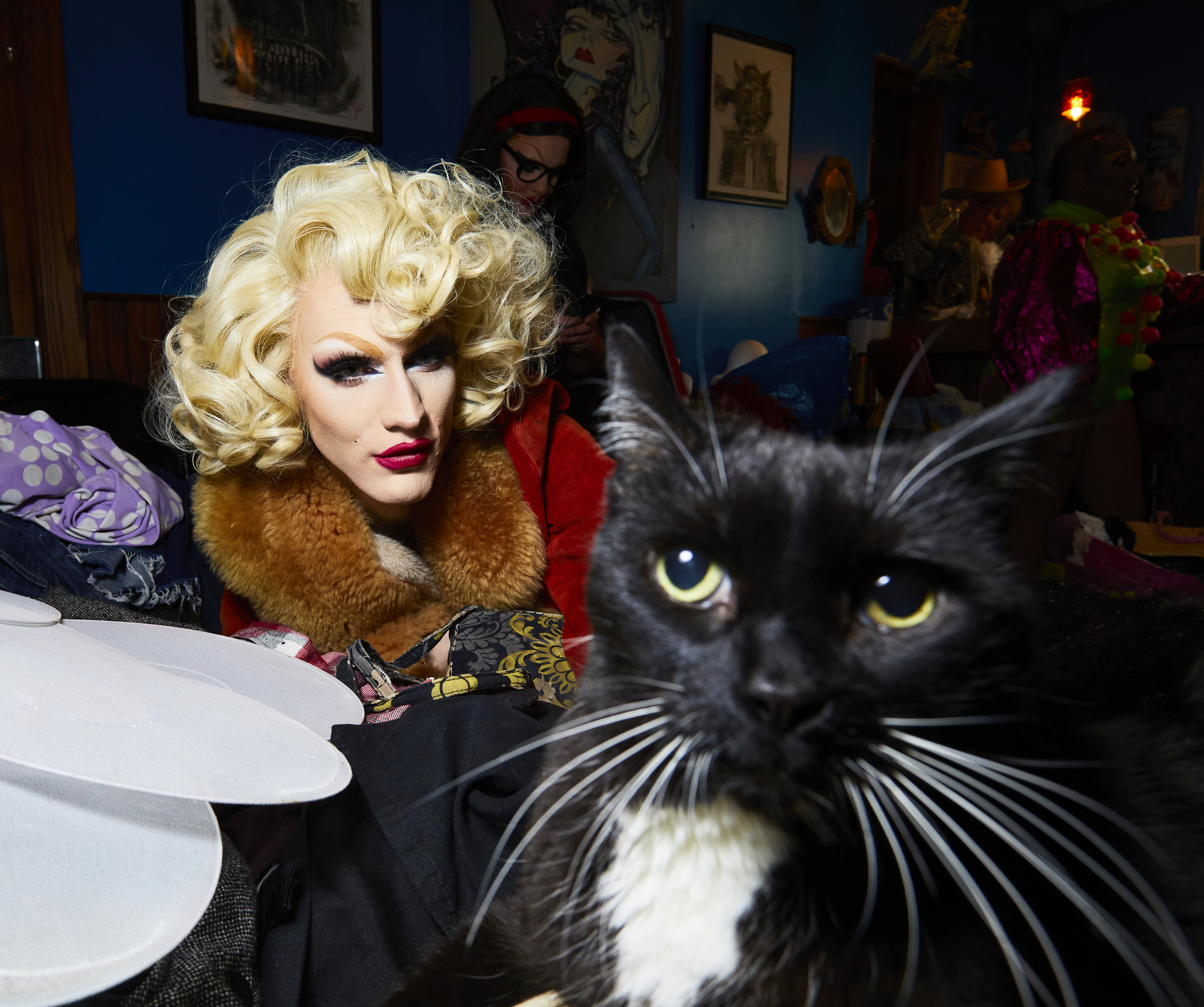 Portrait of drag queen Judy Darling and Lux Lounge's resident cat.