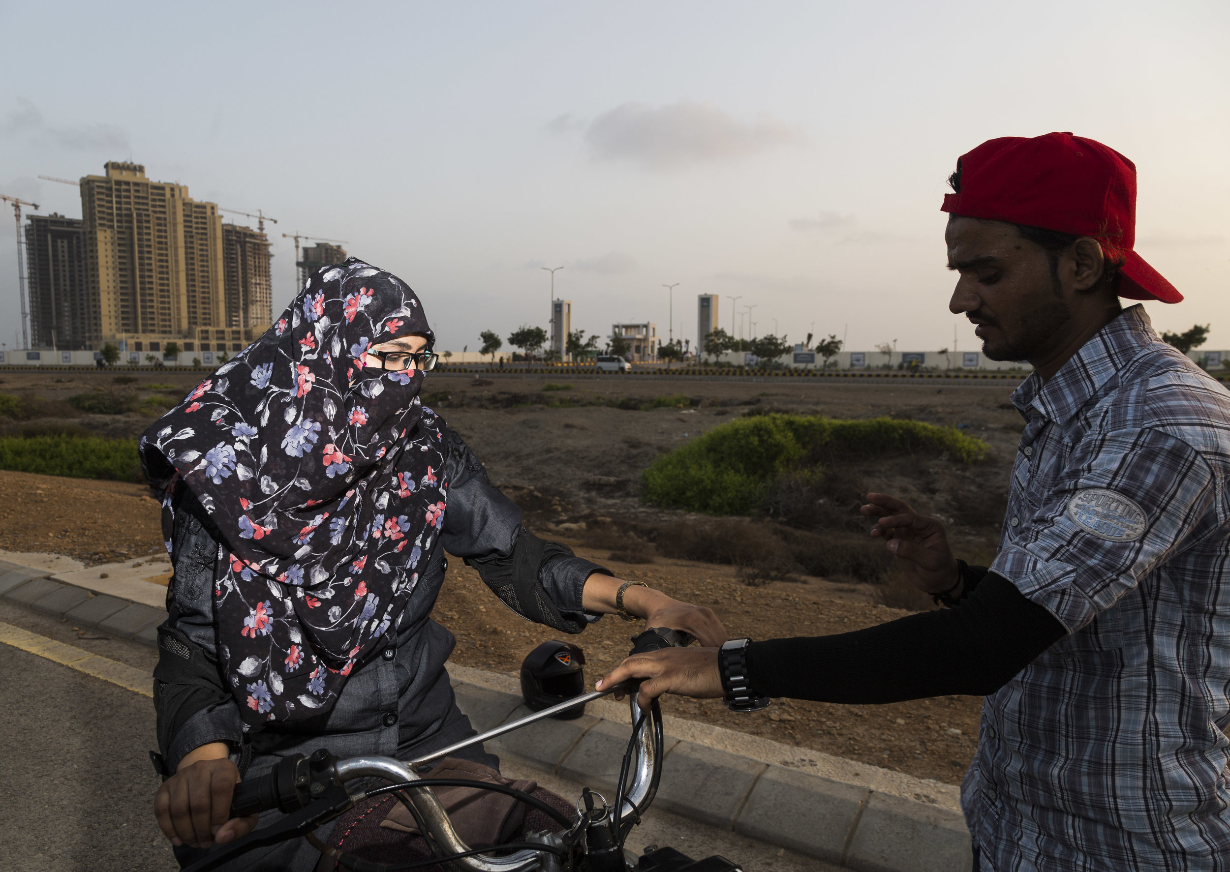 Members of the Pink Riders learn to ride motorcycles in Karachi, Pakistan on June 23, 2019.