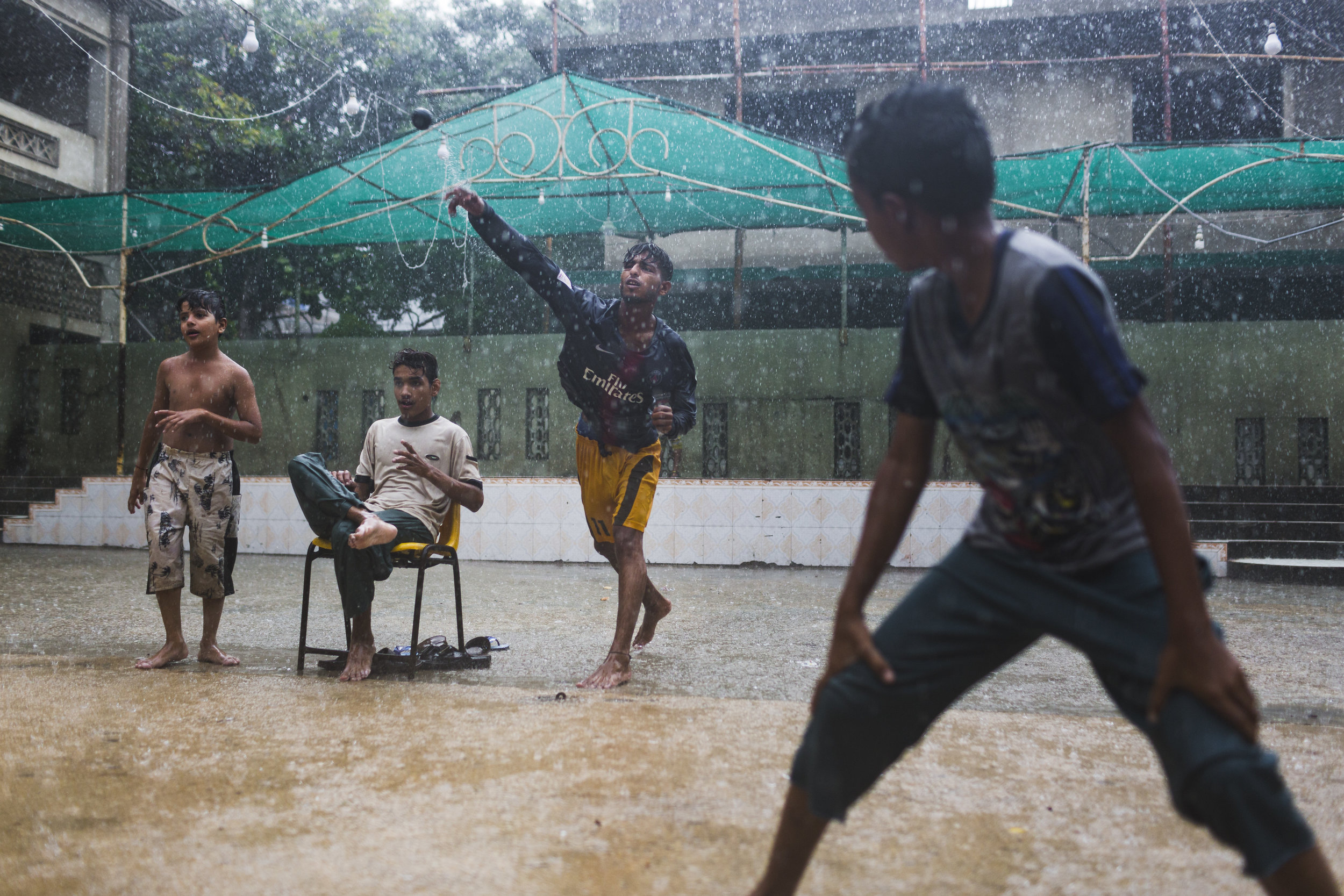 Lyari youth play cricket in torrential rains in Karachi, Pakistan on Tuesday July 30, 2019. The municipal government has released a weather advisory of monsoon rains and thunderstorms that may continue through Friday.