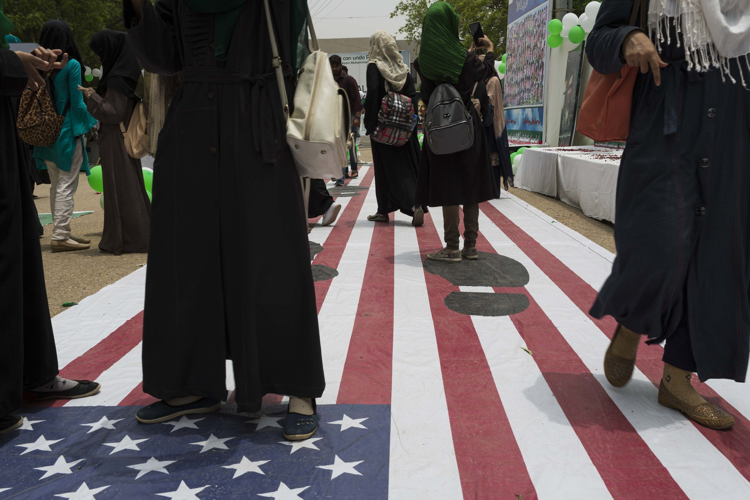Students at the University of Karachi attend an exhibition honoring heroes and martyrs, as Pakistan Independence Day grows nearer, on Thursday Aug 8, 2019.