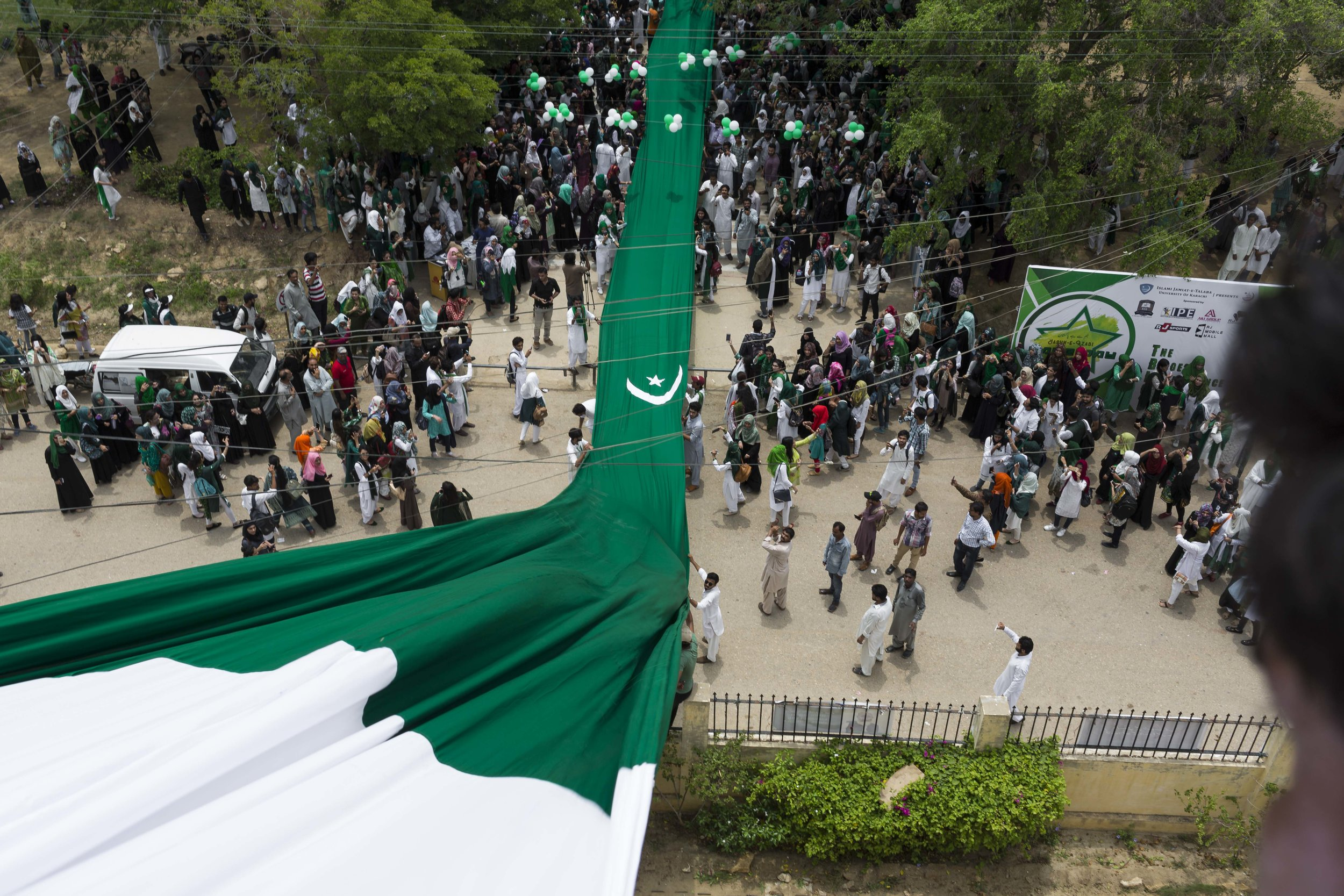 Students at the University of Karachi celebrate Cake Day, as Pakistan Independence Day grows nearer, on Thursday Aug 8, 2019.
