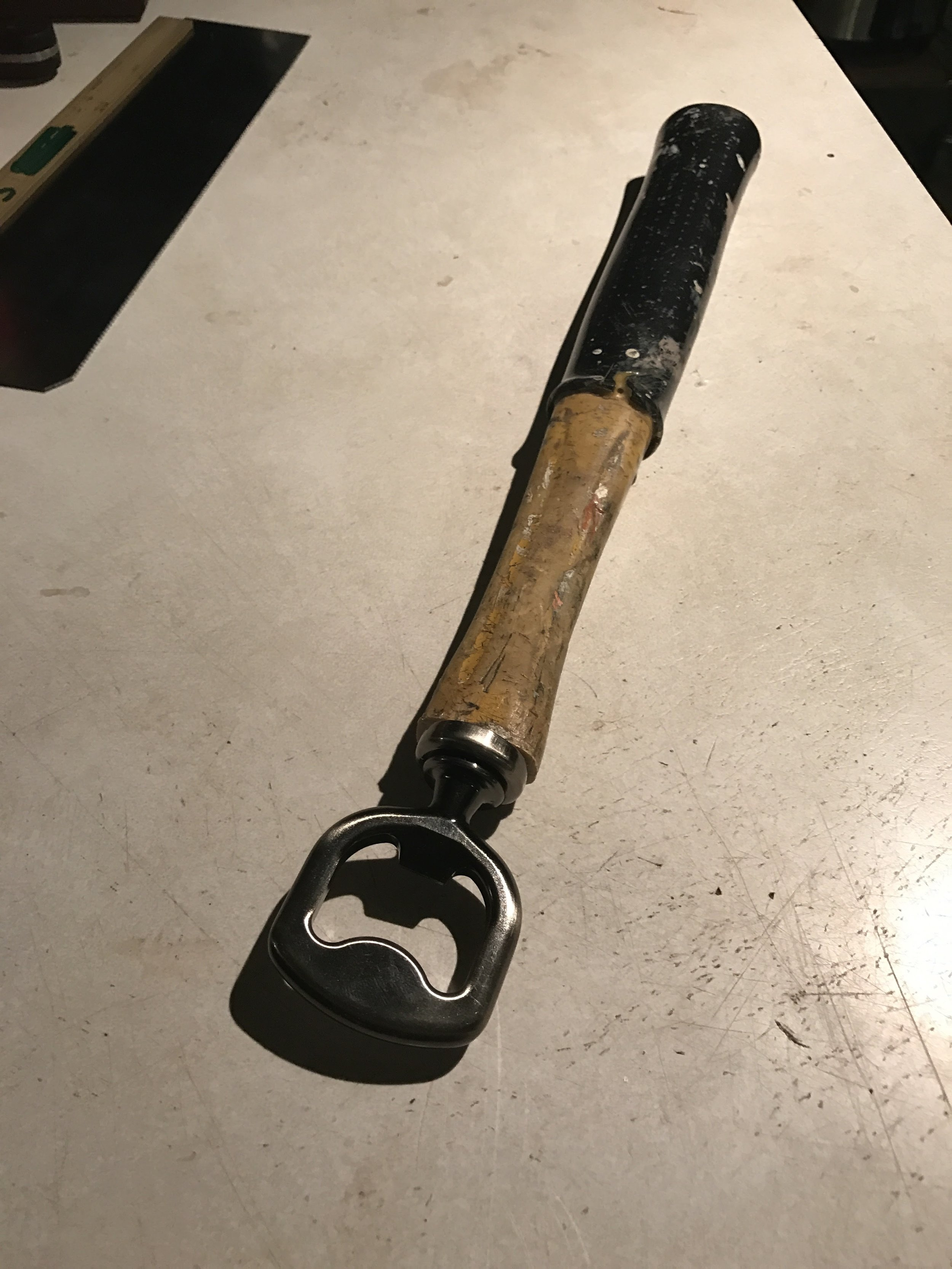 This year I made the old hammer handle into a beer bottle opener and gave it him as another Christmas present.