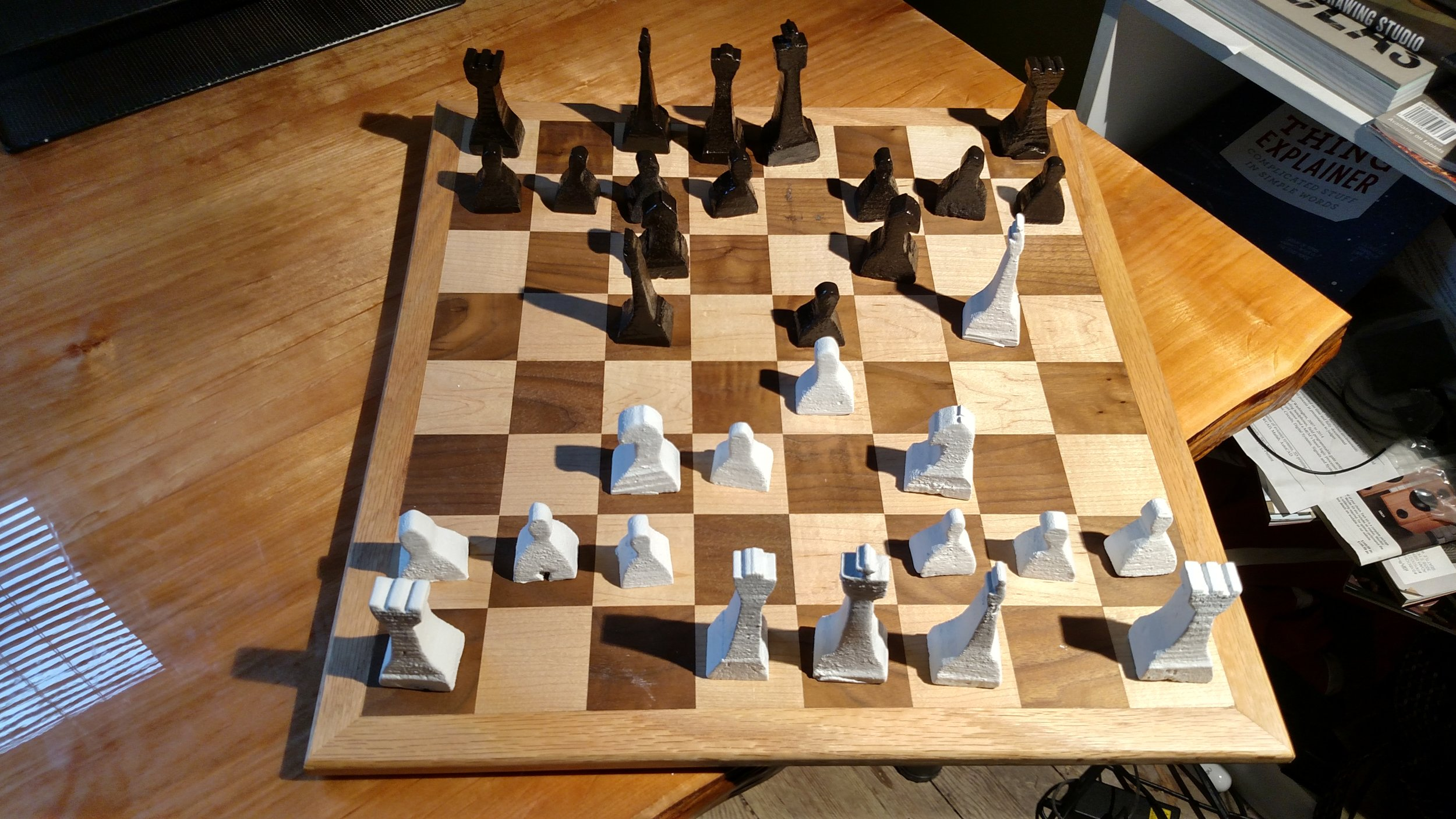 A game being played with the cast Aluminum set.