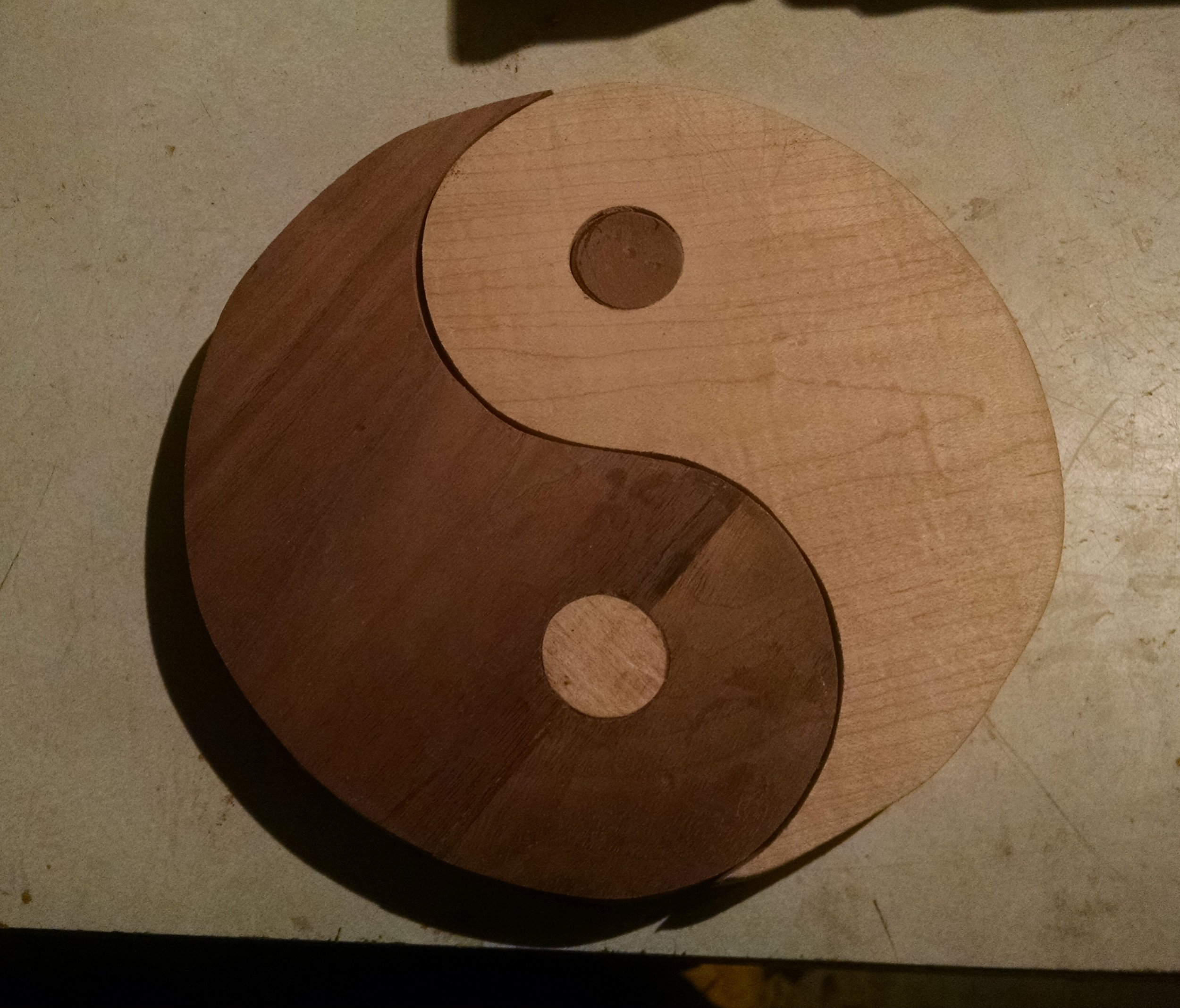 The most important thing in life is balance. I made this ying yang symbol out of walnut and maple for my friend Colleen.