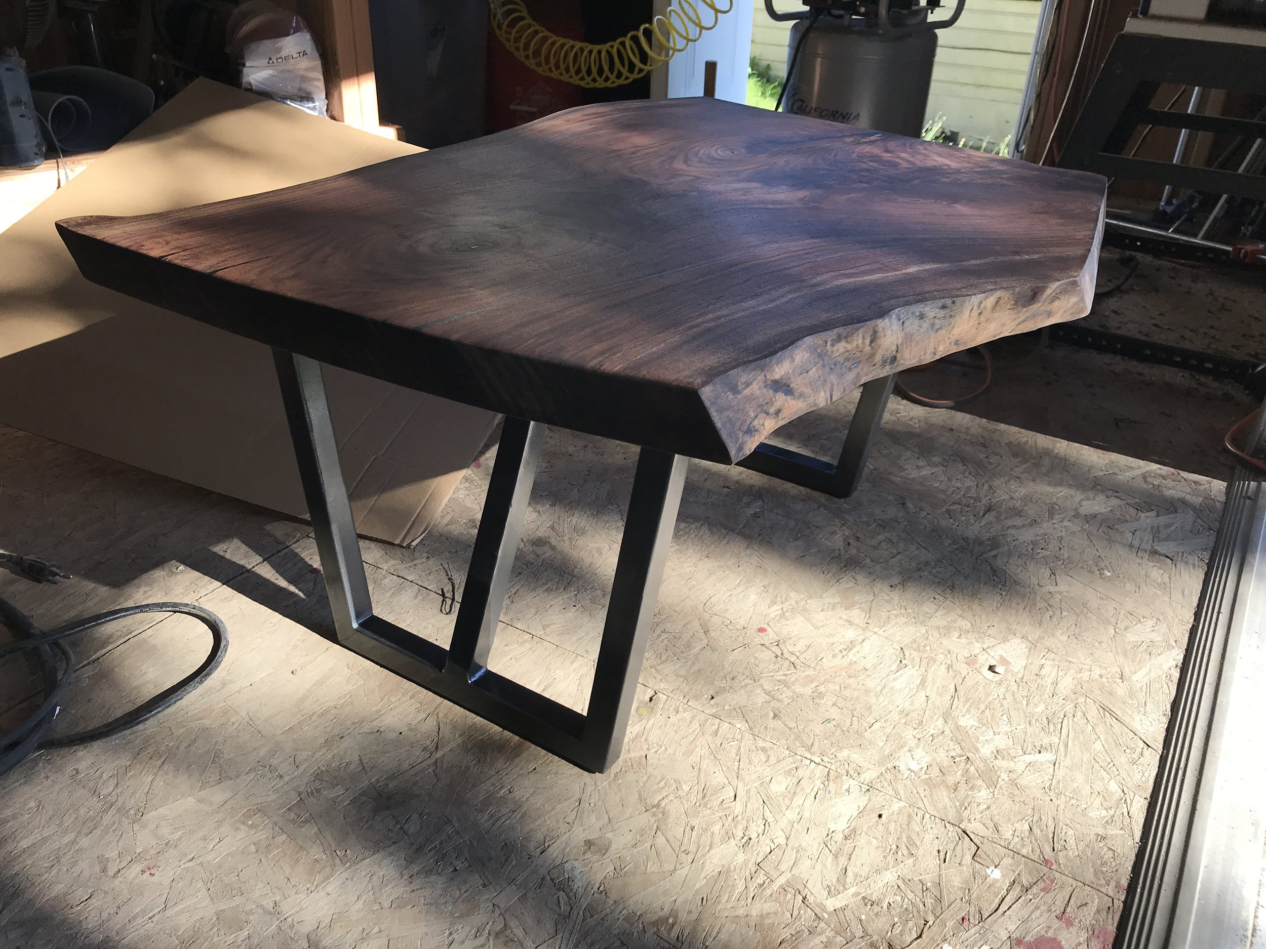 Live edge walnut slab coffee table I made as a wedding present for my friends Matt and Pria!