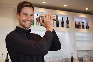 bigstock-Smiling-bartender-shaking-cock-60046682.jpg
