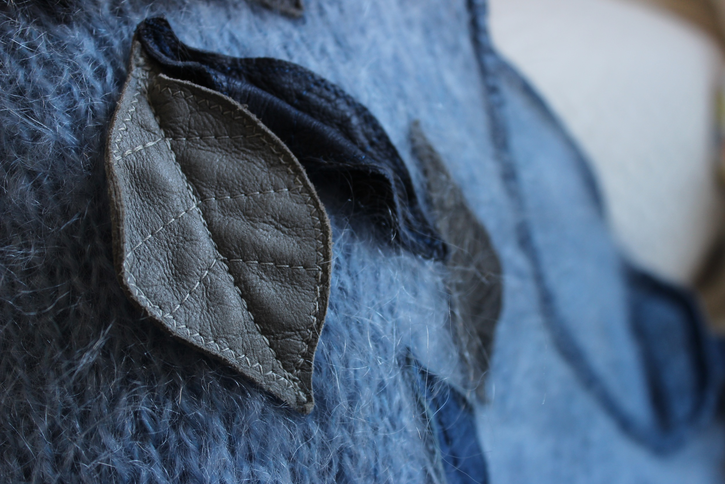 Leather detail, hand sewn on to mohair