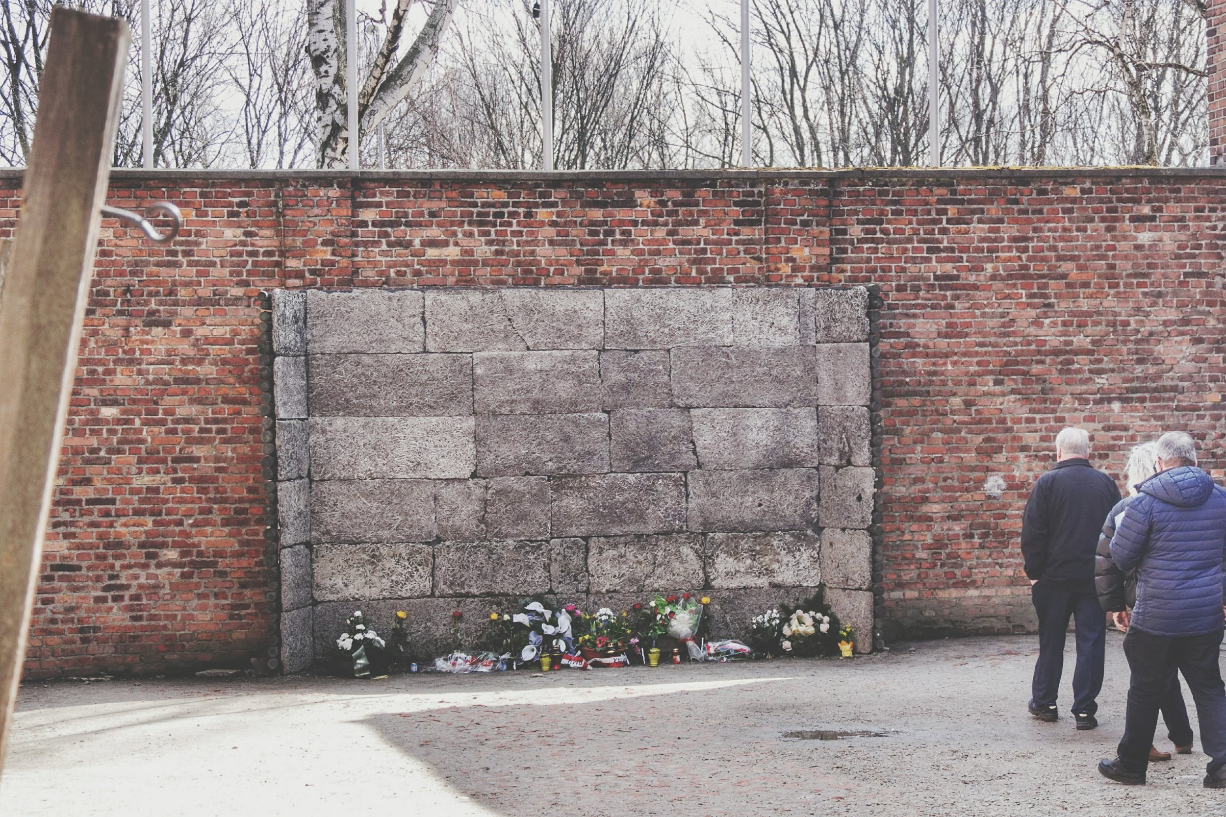 The shooting wall. To the left, the poles for hanging people by the wrists.