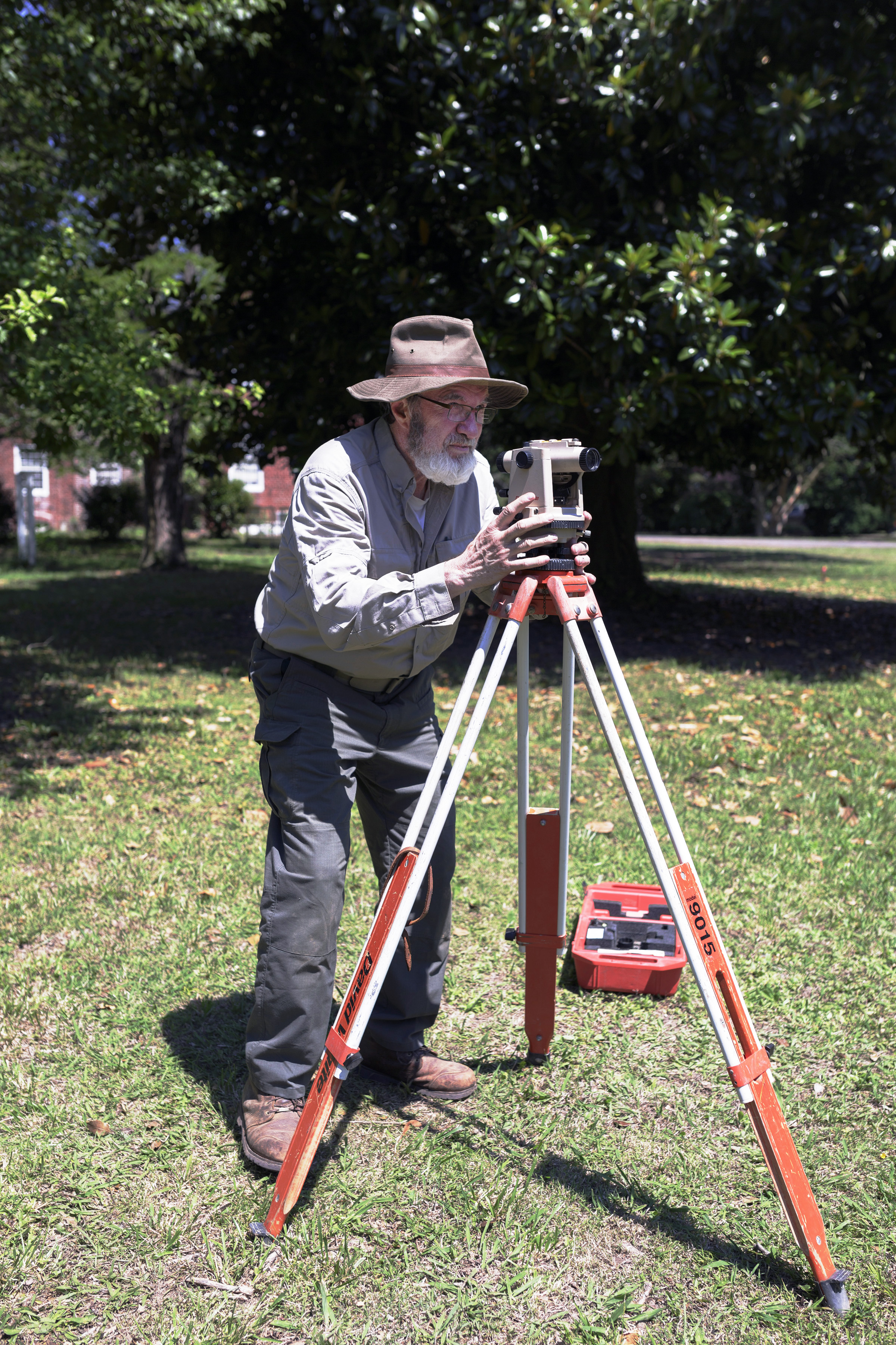 Len Blasiol measures for a level digging site at an archeological dig taking place on the Eyreville Plantation grounds near Cape Charles, Virginia.