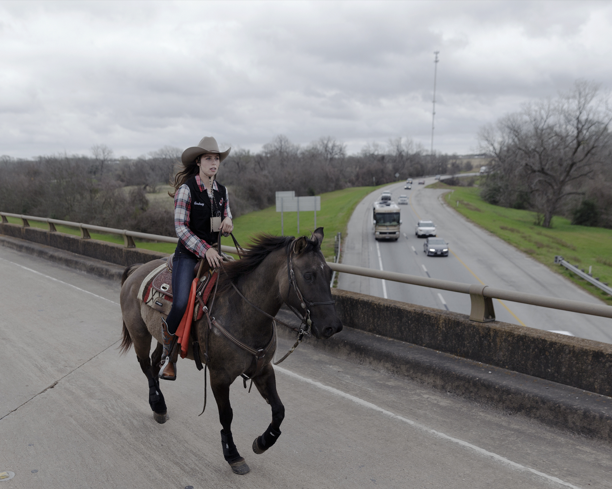 A member of the Valley Lodge Trail Ride crosses over a highway overpass. In many ways, Fulshear is at an intersection of what was, is, and can be.