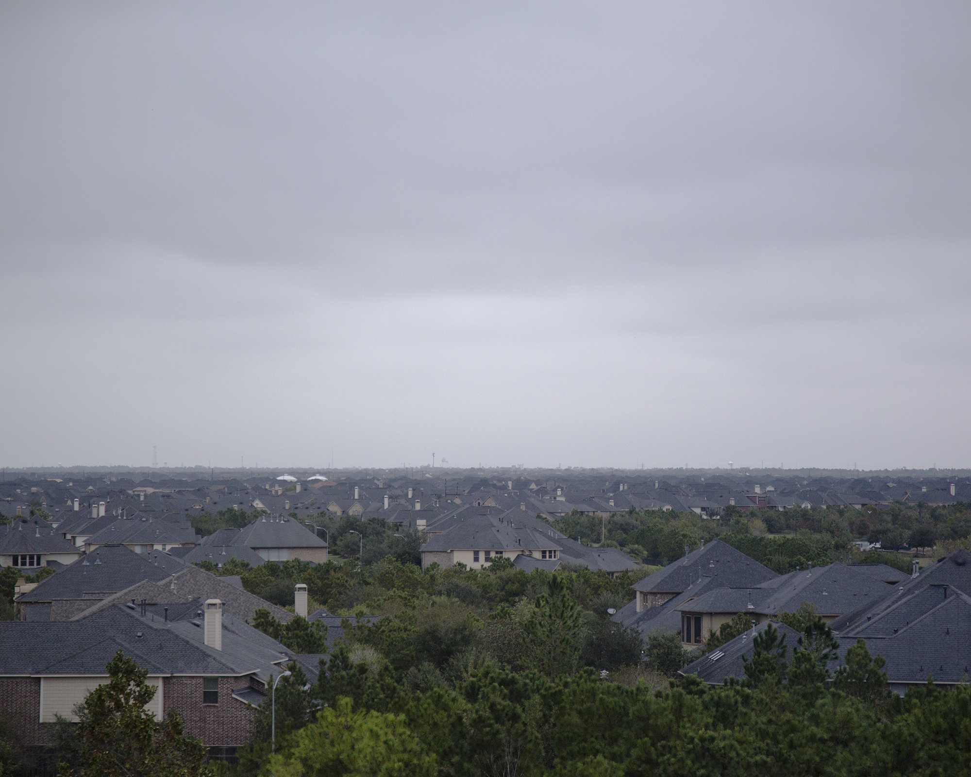 Master-plan housing communities have replaced vast prairies, where crops sprouted and cattle once grazed, in Fulshear, Texas. With a population of just 1,134 individuals in 2010, the town west of Houston has grown over 2,000 percent in under a decade.